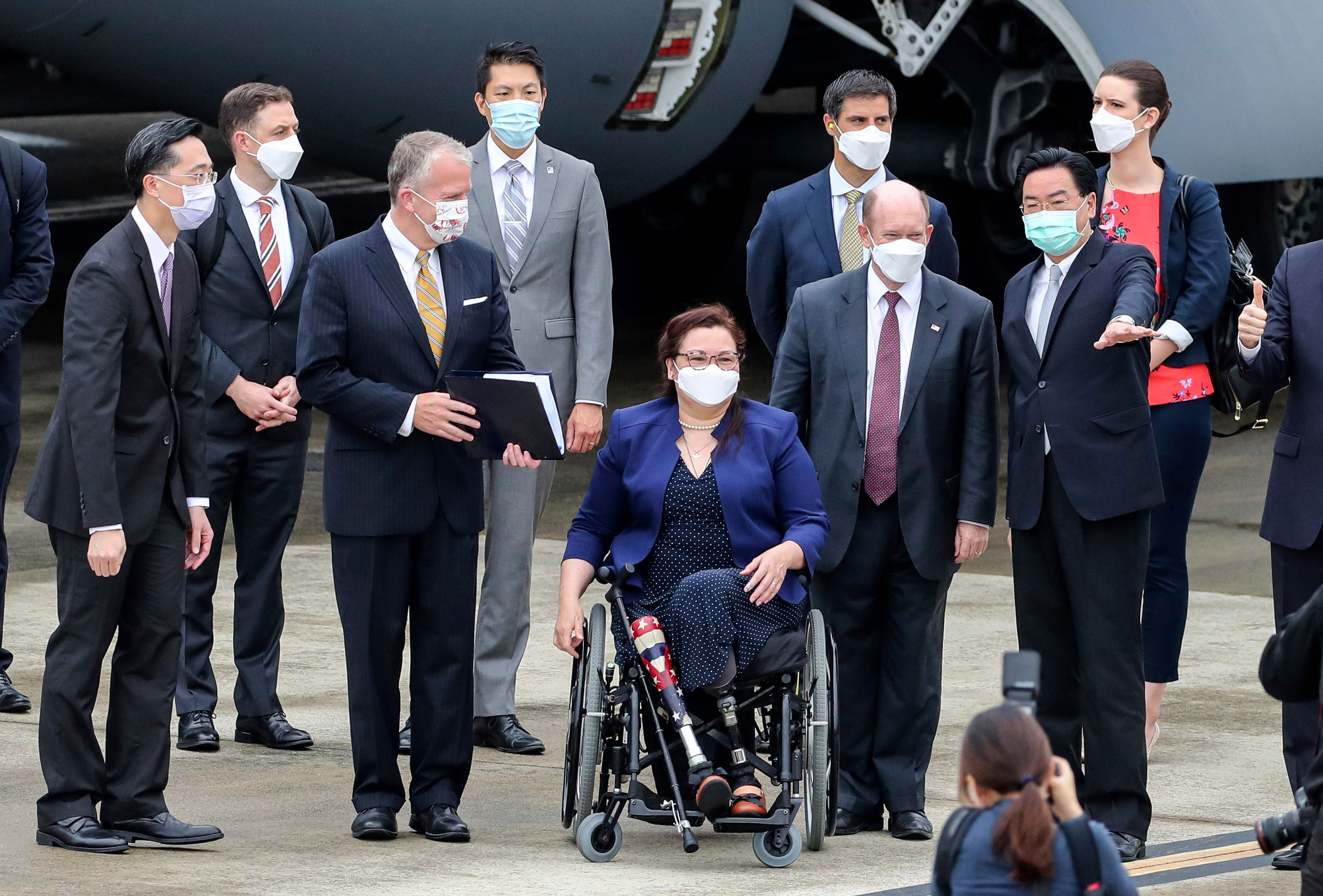Taiwan's Foreign Minister Joseph Wu, right, gestures as he welcomes US Sens. Christopher Coons, Tammy Duckworth and Dan Sullivan at Songshan Airport in Taipei, Taiwan, on June 6.