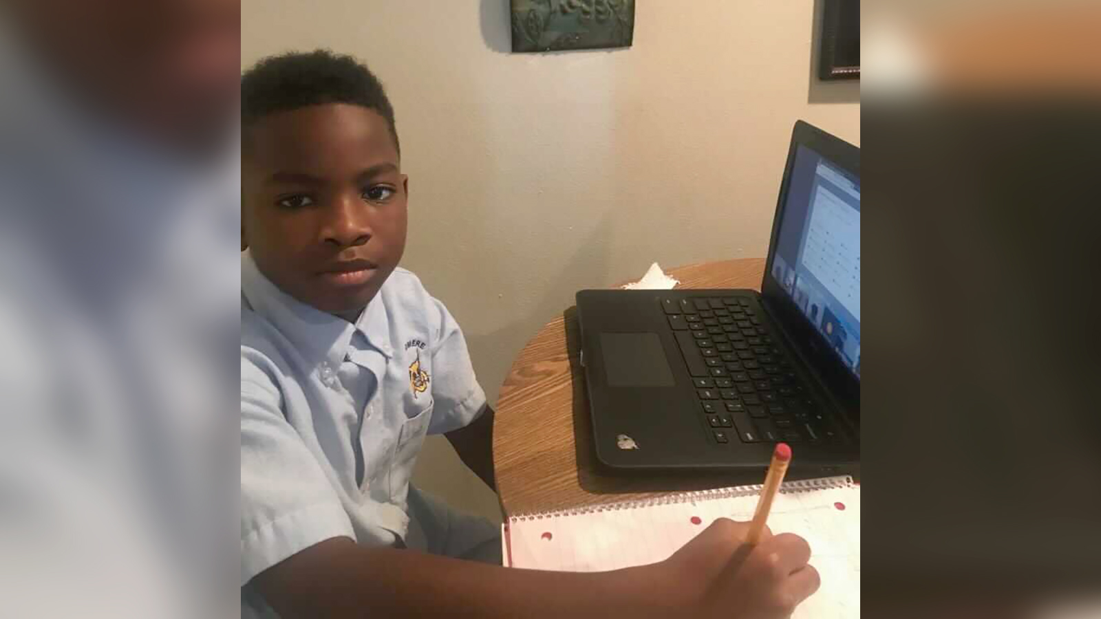 Ka Mauri Harrison, 9, pictured in his home participating in virtual learning.
