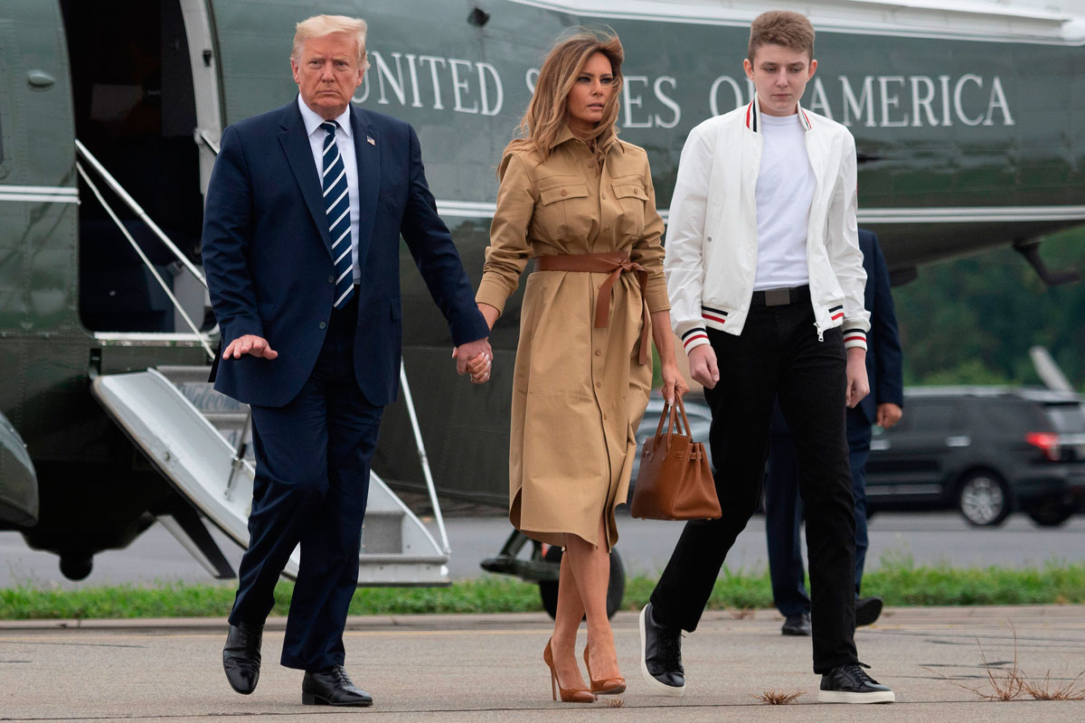 In this August 16 file photo, President Donald Trump walks with First Lady Melania Trump and their son Barron as they arrive at Morristown Municipal Airport in Morristown, New Jersey.