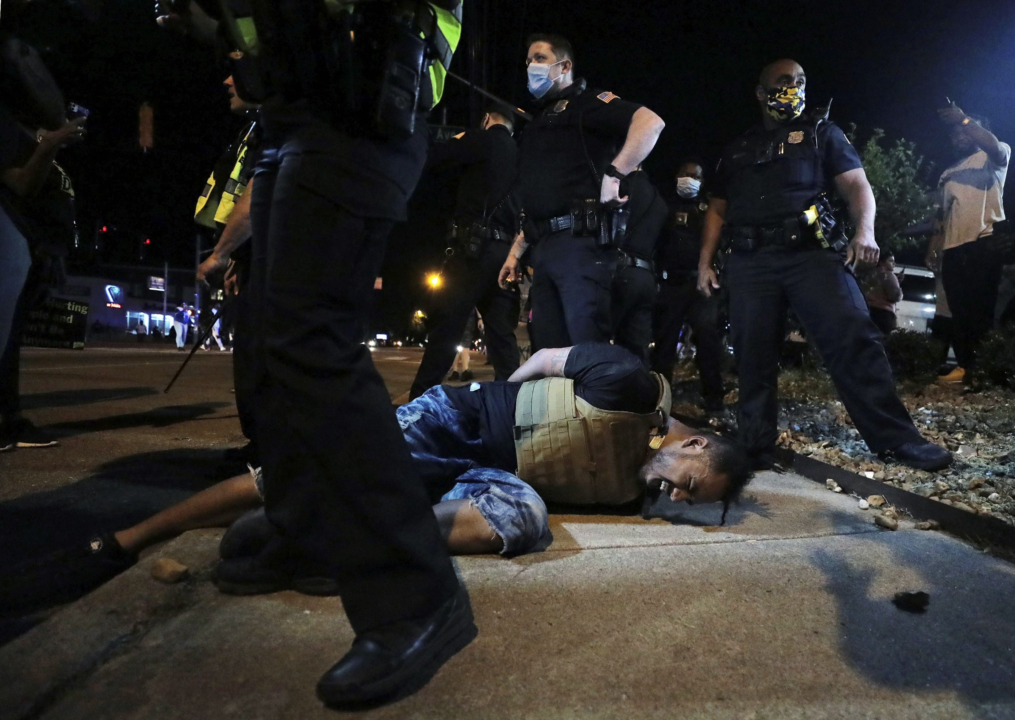 A person winces in pain after being pepper sprayed by police during a protest in Memphis, Tennessee, on May 28.