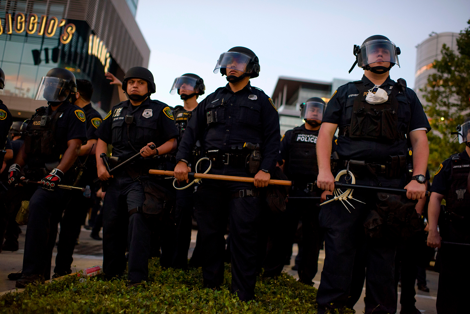 Police officers stand guard after a peaceful march to mourn the death of George Floyd in downtown Houston, on Tuesday, June 2.