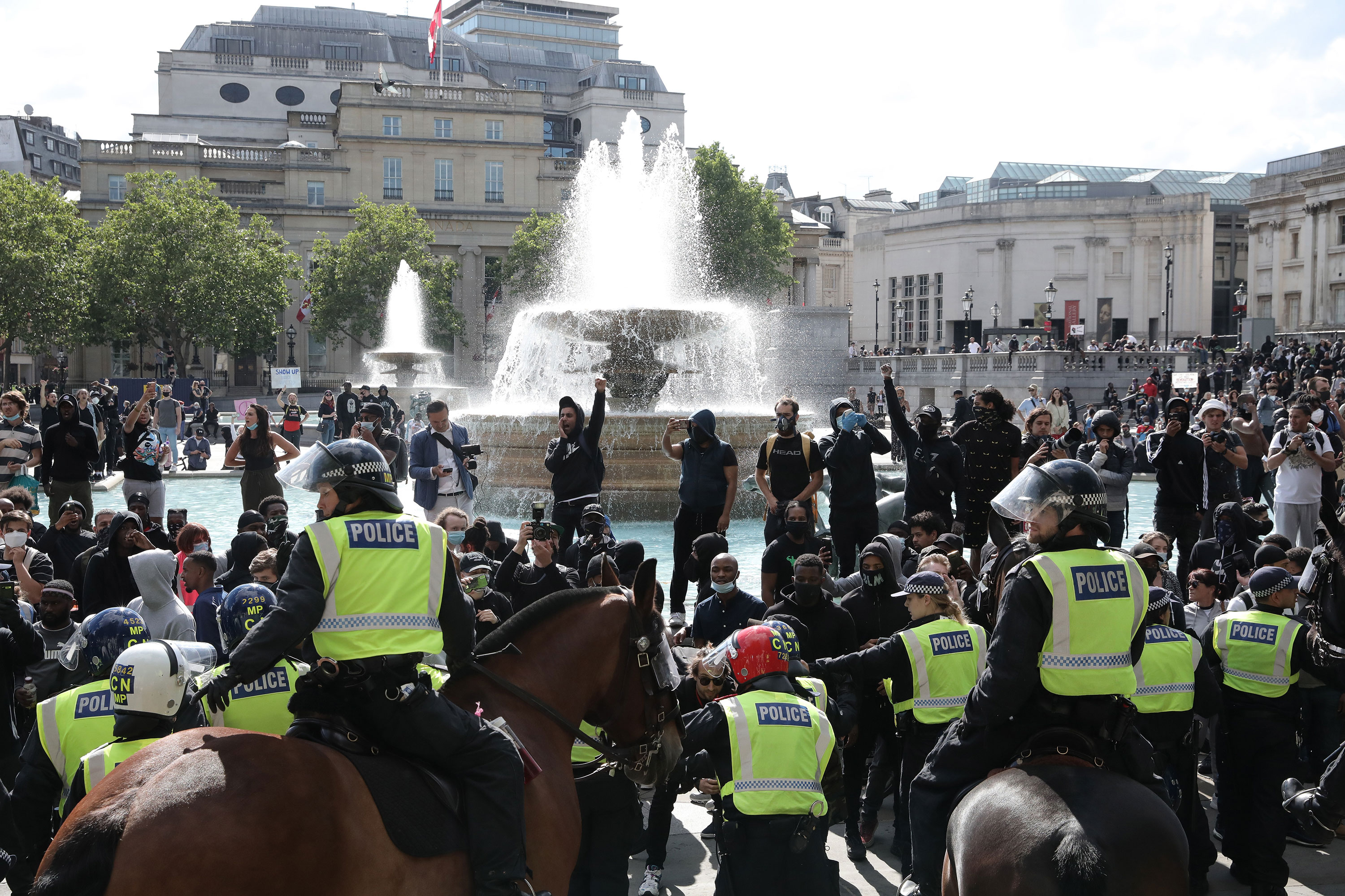 Police monitor protesters in London, England, on June 13.