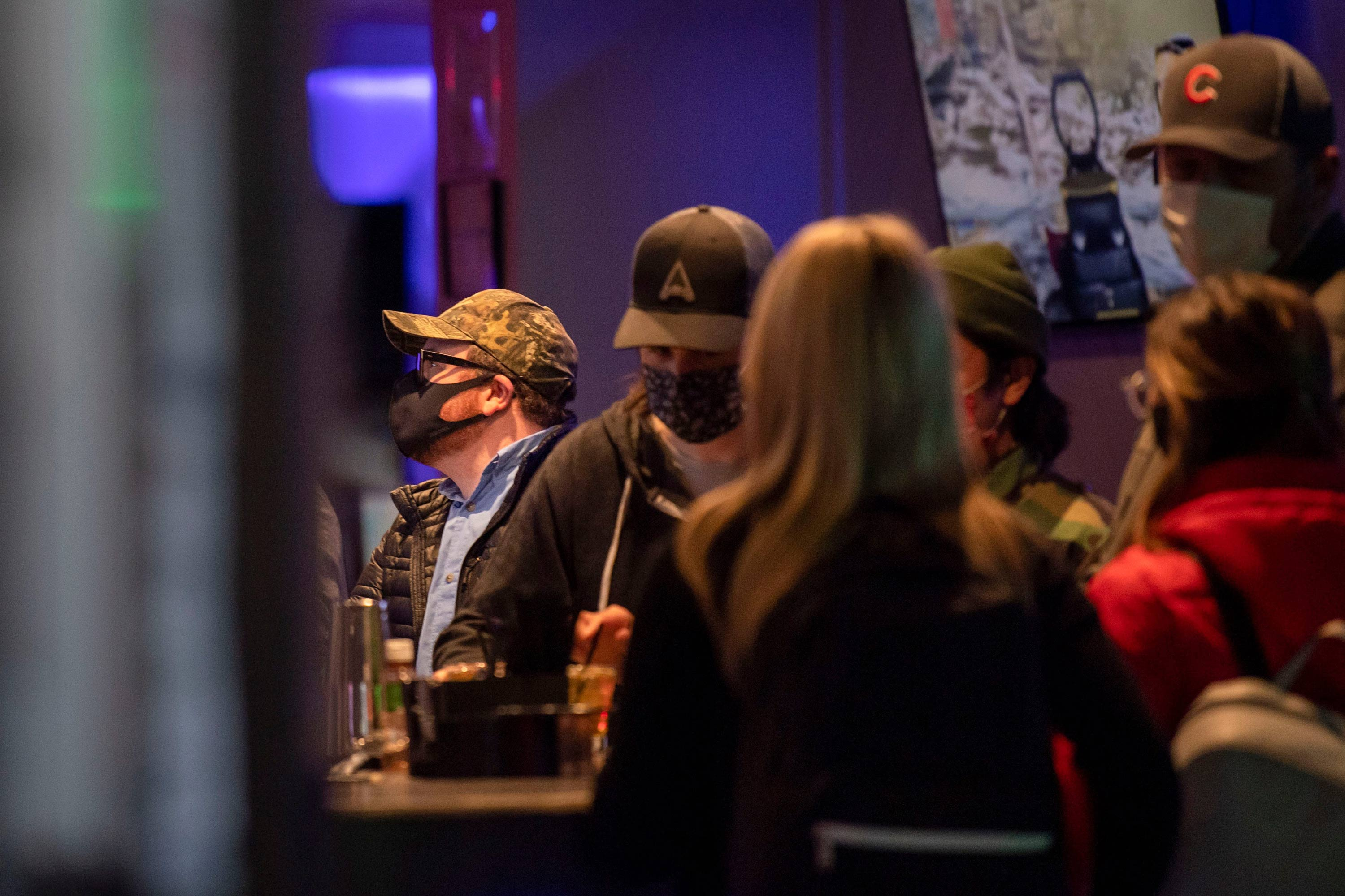People stand in Valhalla Esports Lounge on March 2 in Austin, Texas.
