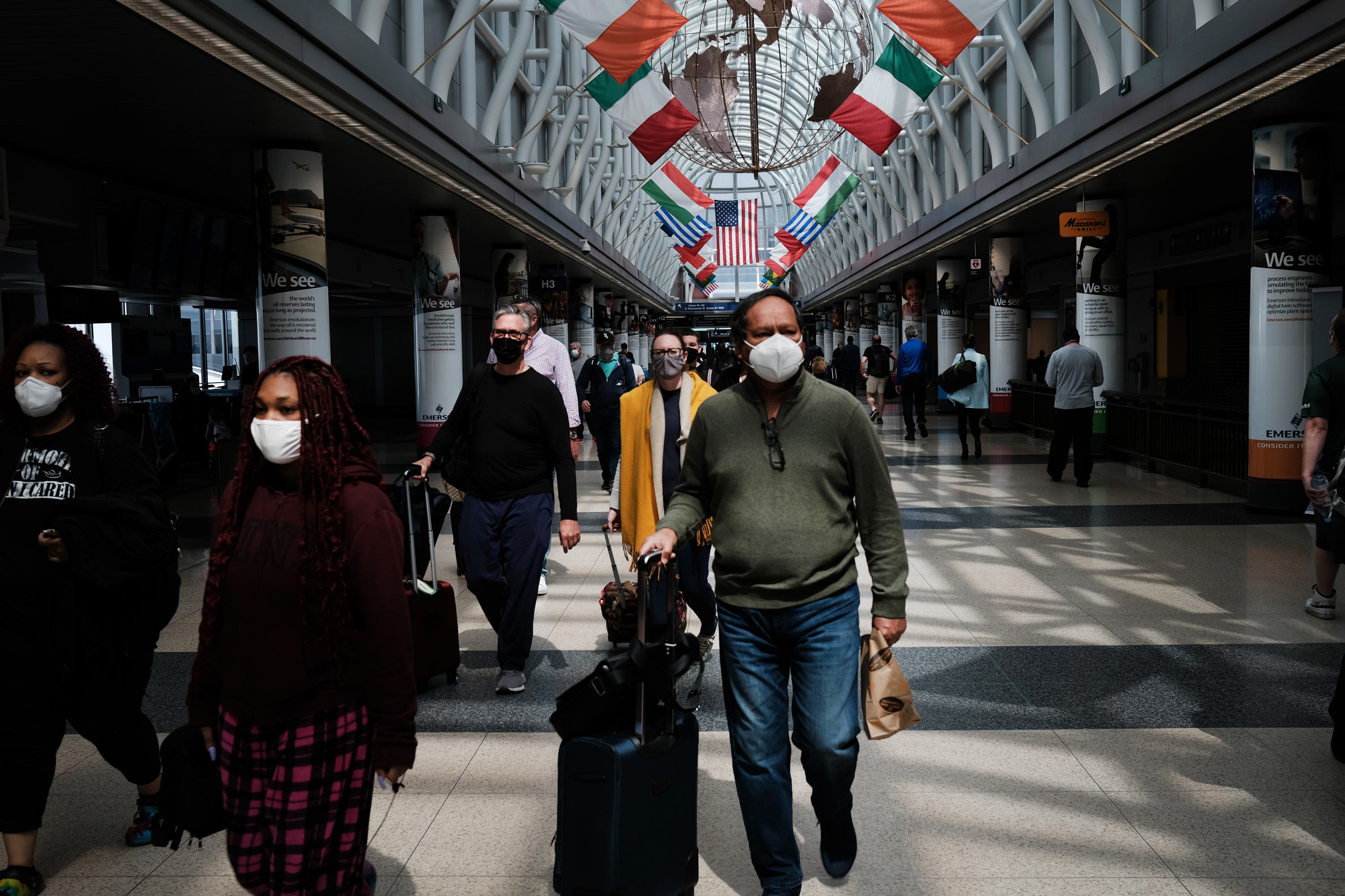 People walk through Chicago O'Hare airport on April 26 in Chicago.