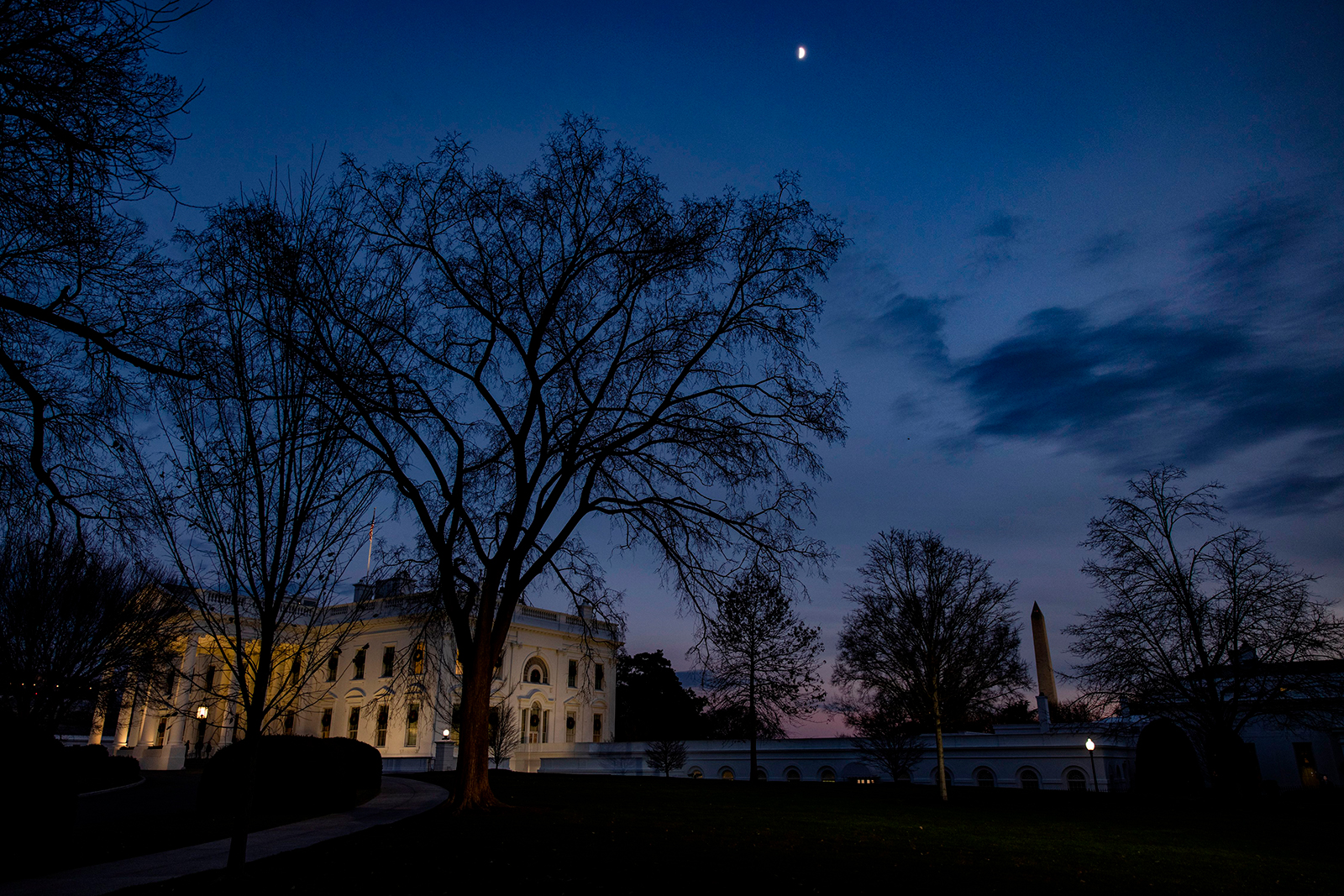 Dusk falls over the White House in Washington, DC on December 21.