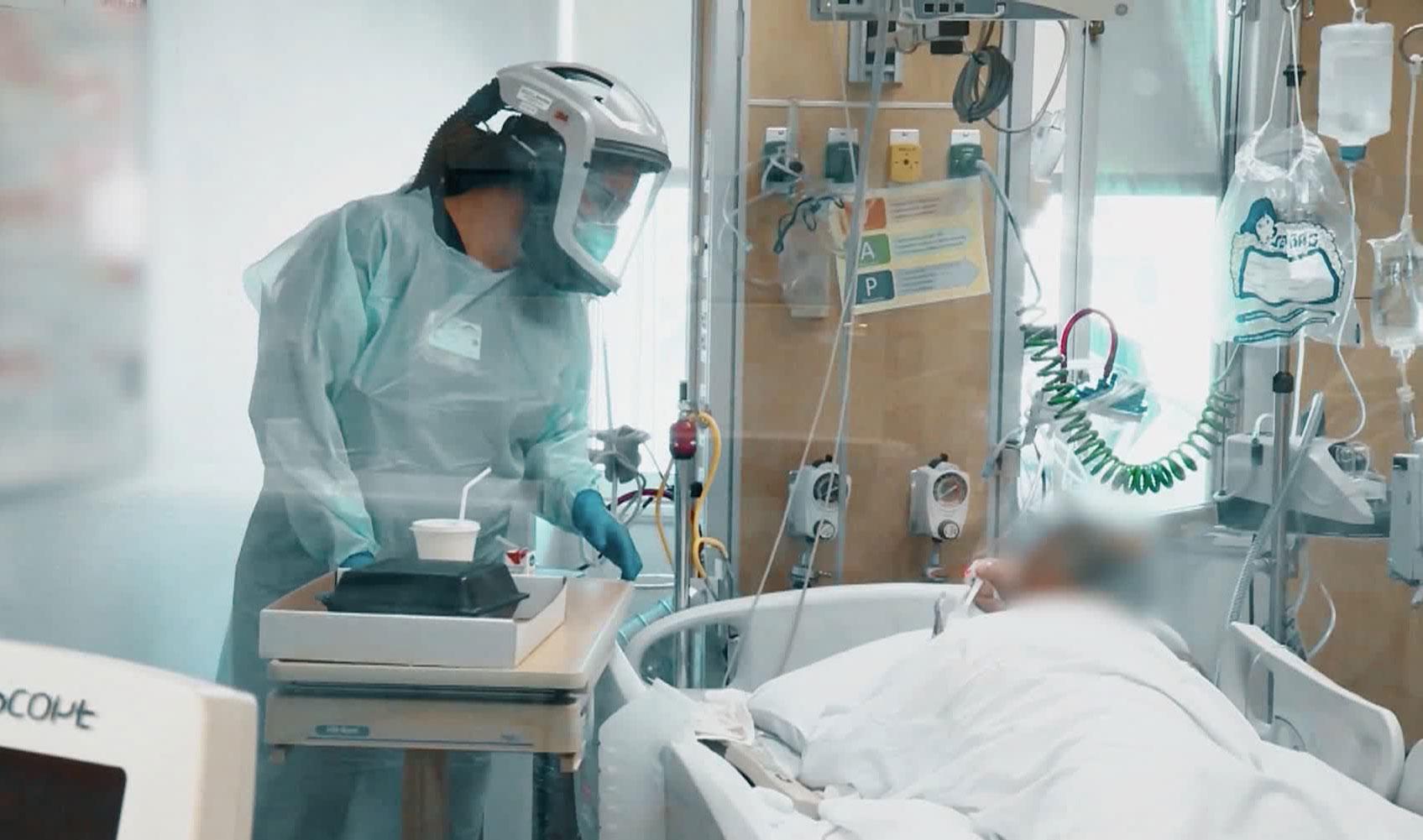 A nurse attends to a coronavirus patient at El Centro Regional Medical Center in El Centro, California.