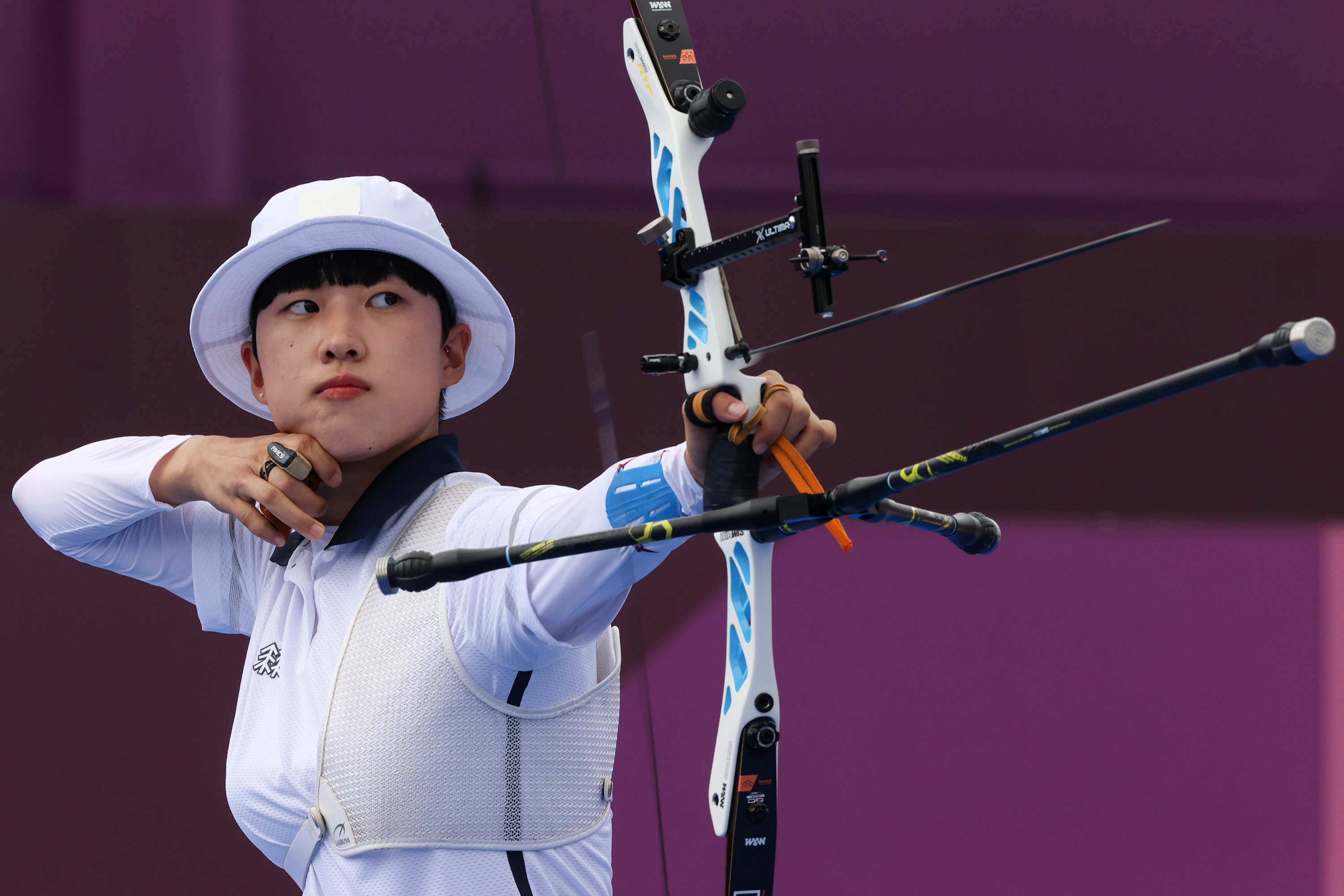 South Korea's An San competes in the women's individual archery event on Friday, July 30.