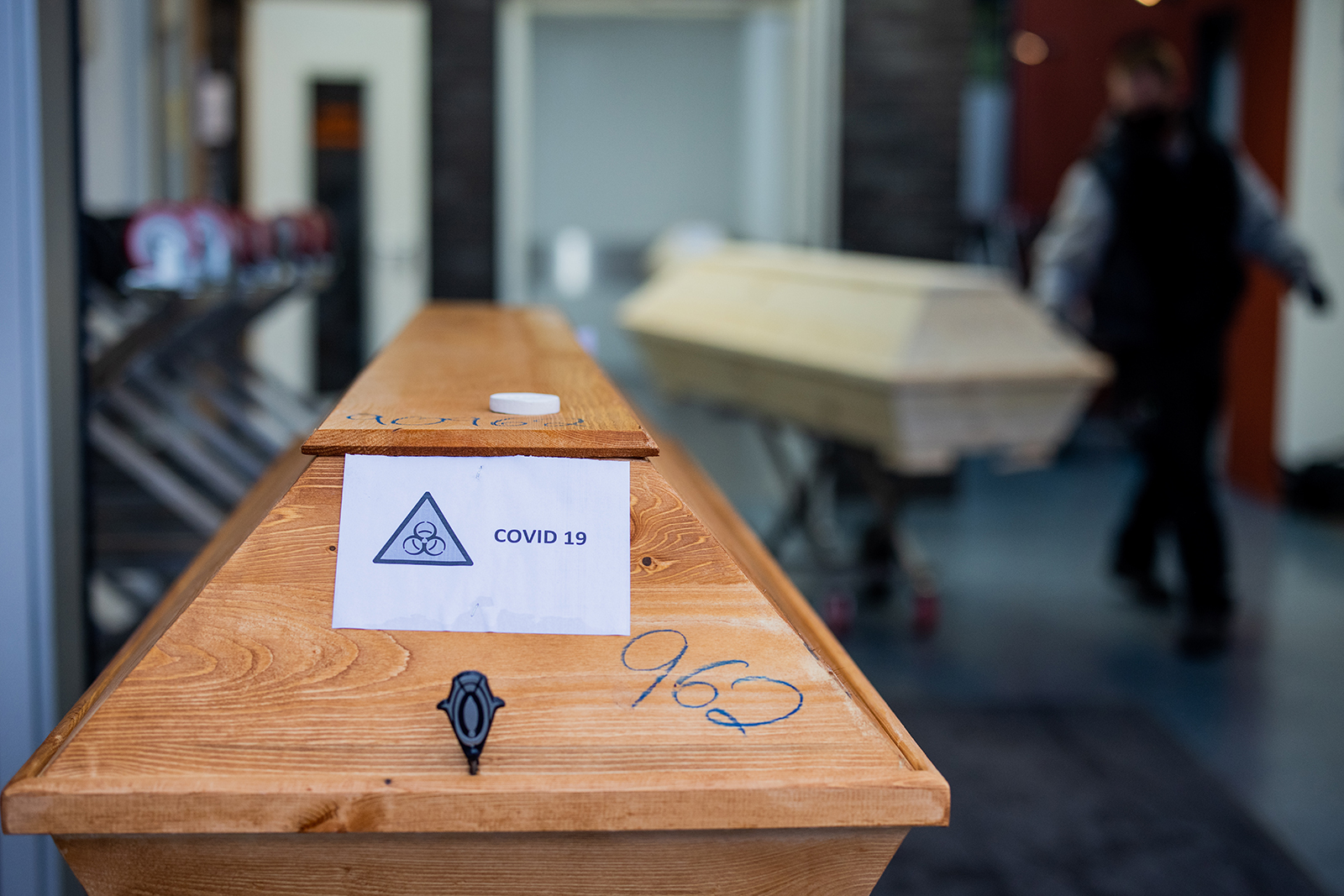 """A coffin labeled """"Biohazard Covid-19"""" is seen at a crematorium in Dülman, Germany, on January 19."""