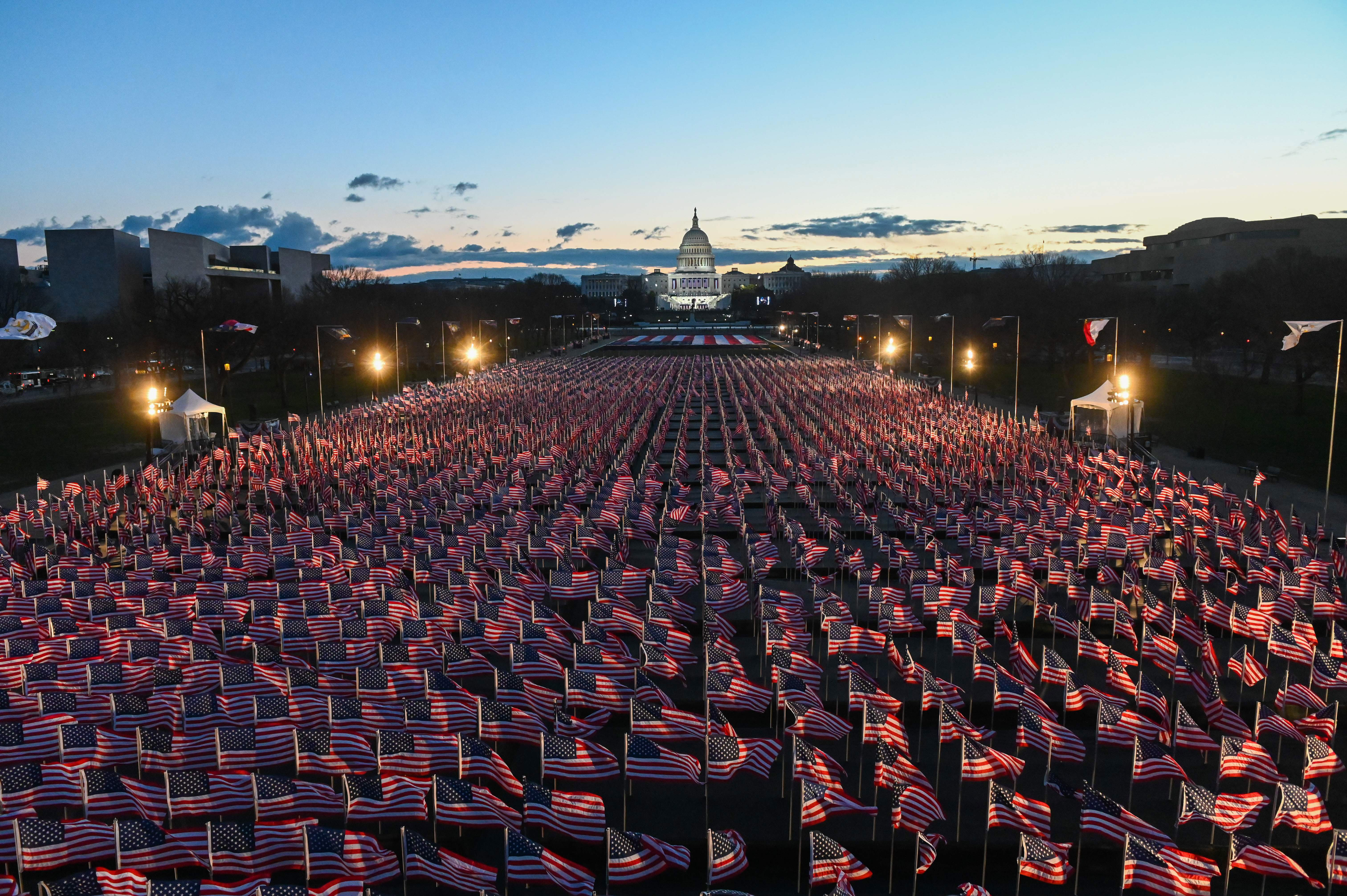 American flags are seen in the early morning as preparations continue for the inauguration of Joe Biden on January 20.