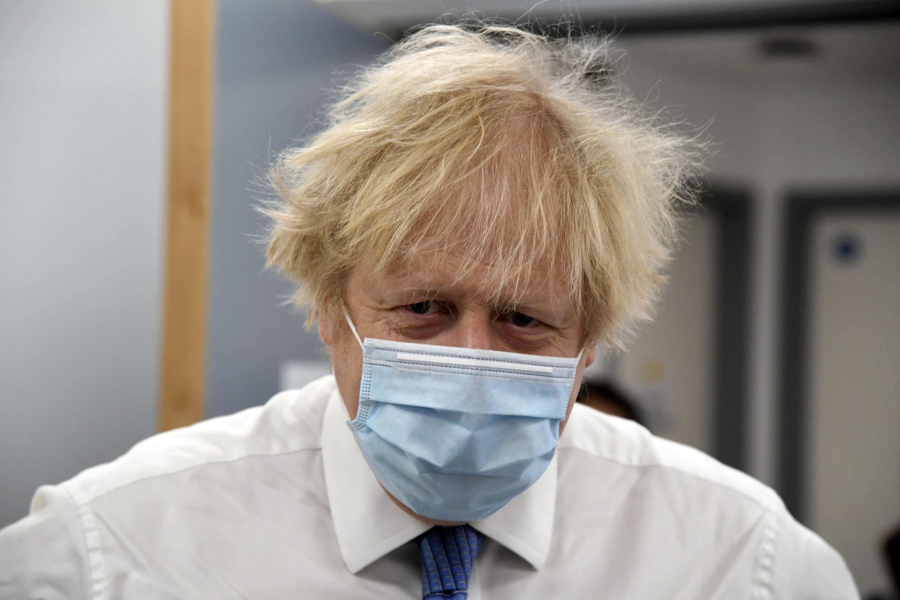 Britain's Prime Minister Boris Johnson is pictured during a visit to a coronavirus vaccination center in Orpington, south-east London, on Monday, February 15.