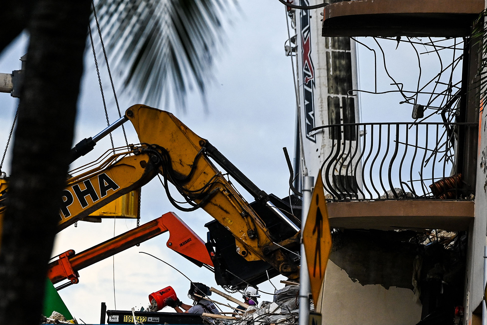 Rescue workers continue to search through rubble at the site of a collapsed building in Surfside, Florida, north of Miami Beach on June 27.