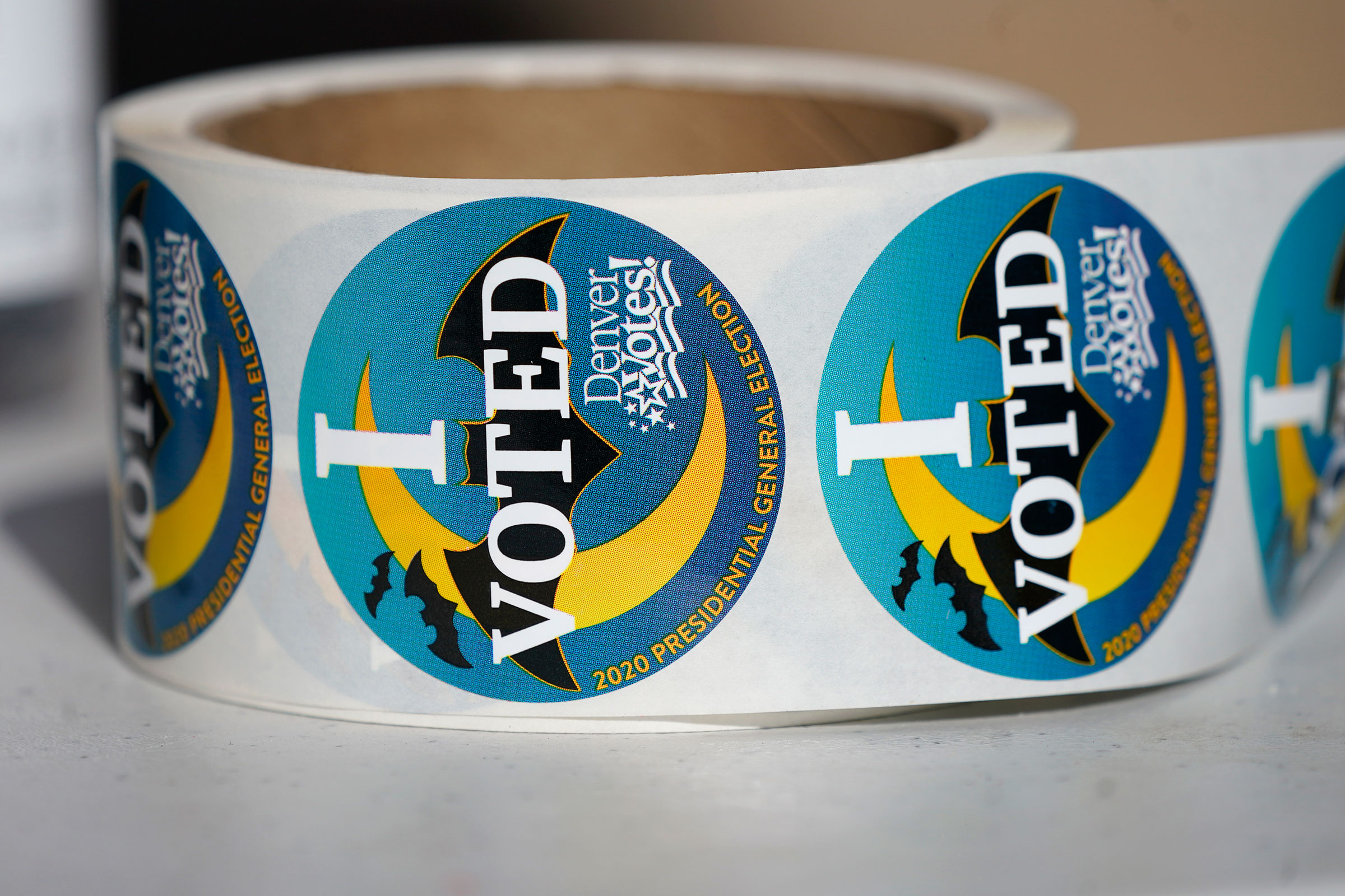 A roll of stickers sits on a table for distribution to voters as they cast their ballots on Friday, October 30 in Denver, Colorado.