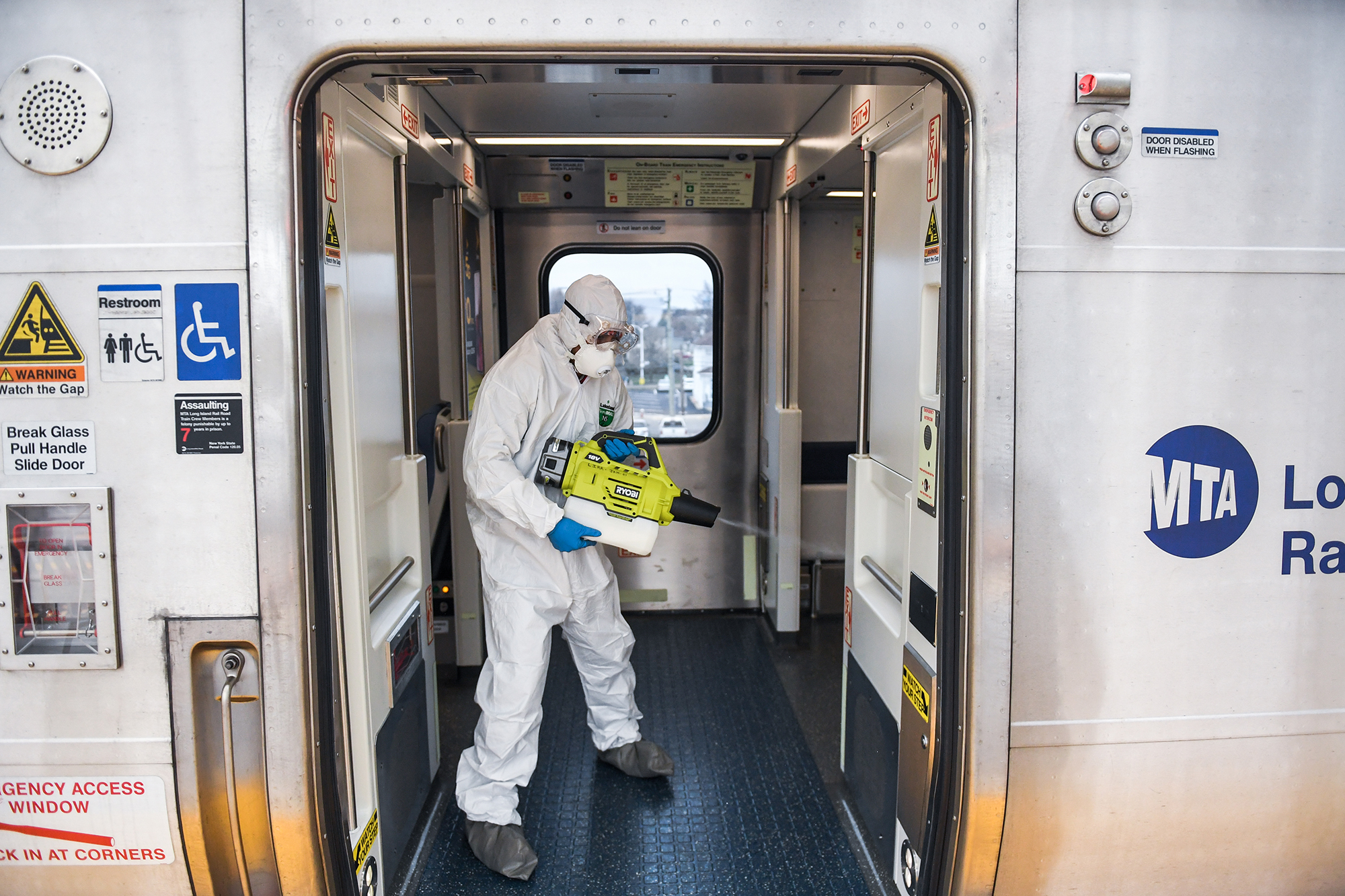 A Long Island Rail Road employee disinfects a train car at the Hicksville, New York, LIRR station on March 19.