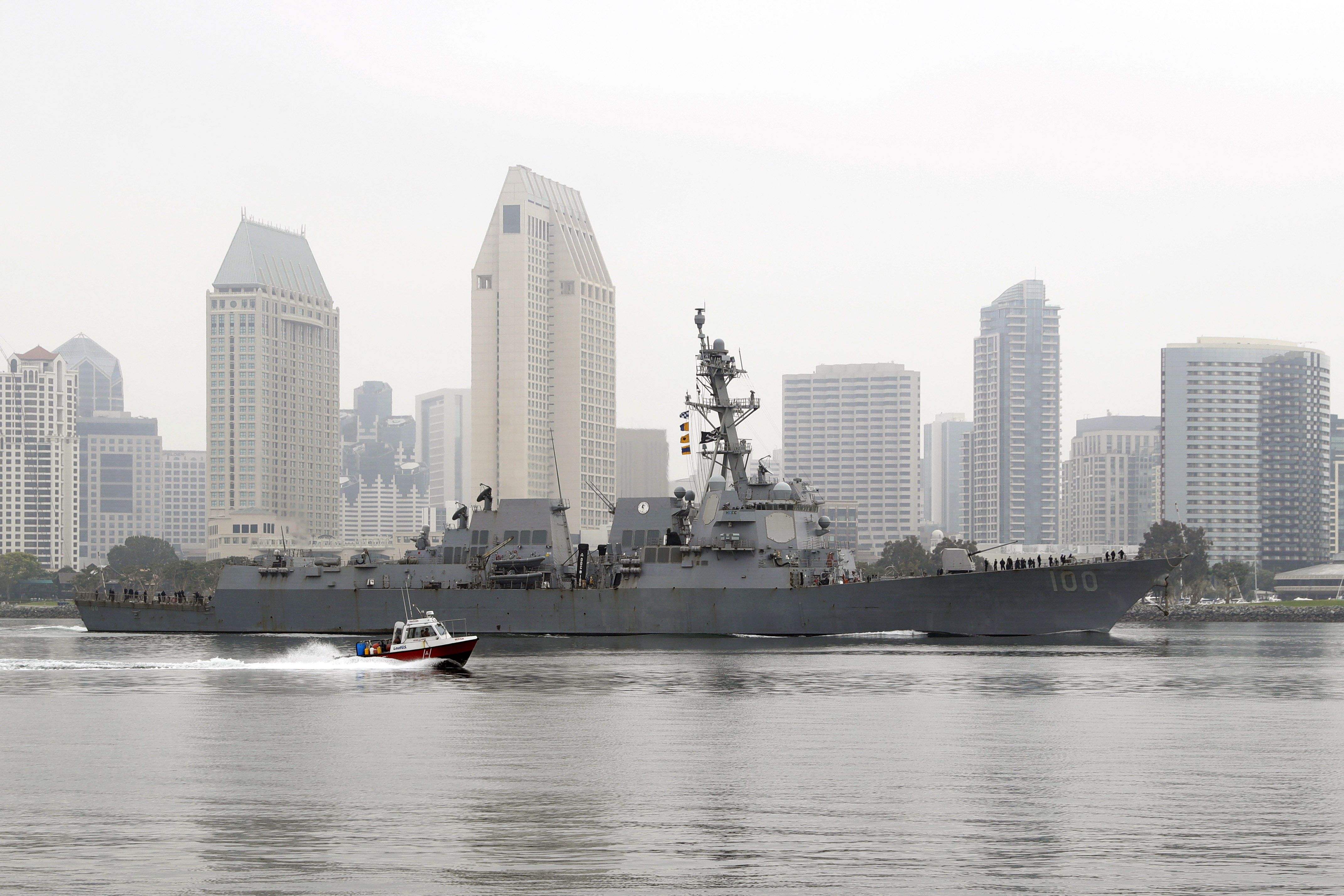 The USS Kidd, as seen from Coronado, California, passes downtown San Diego as it returns to Naval Base San Diego on April 28.