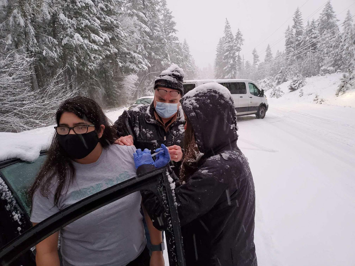 Josephine County Public Health workers administered leftover vaccine doses to motorists who were stranded in a snowstorm.