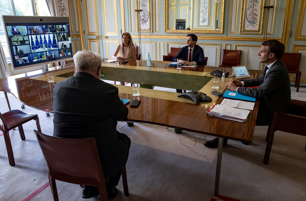 French President Emmanuel Macron attends a video conference call with members of the European Council at the Elysee Palace in Paris, on April 23.