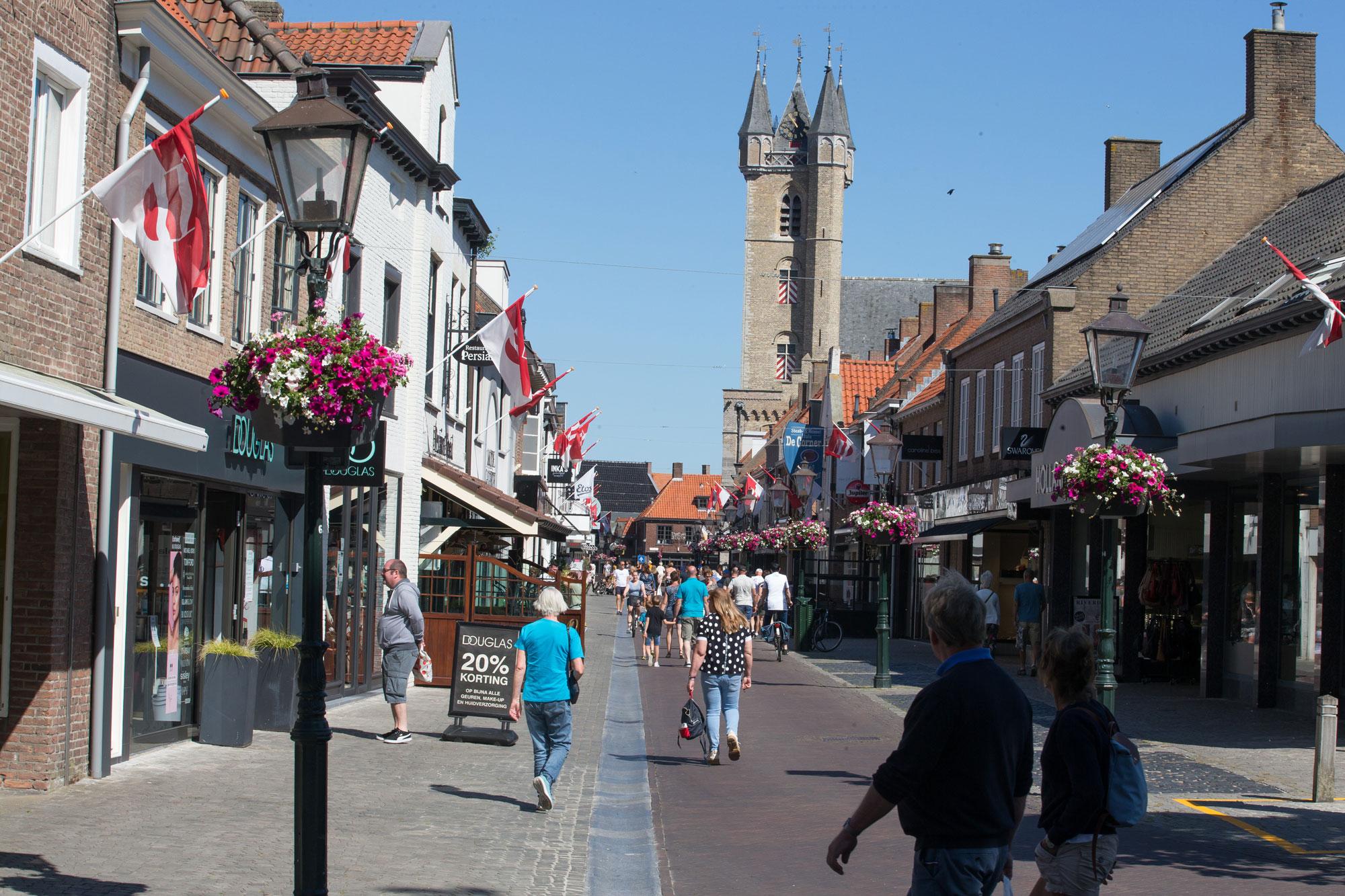People walk on a shopping street in Sluis, Netherlands, near the Belgian-Dutch border on May 31.