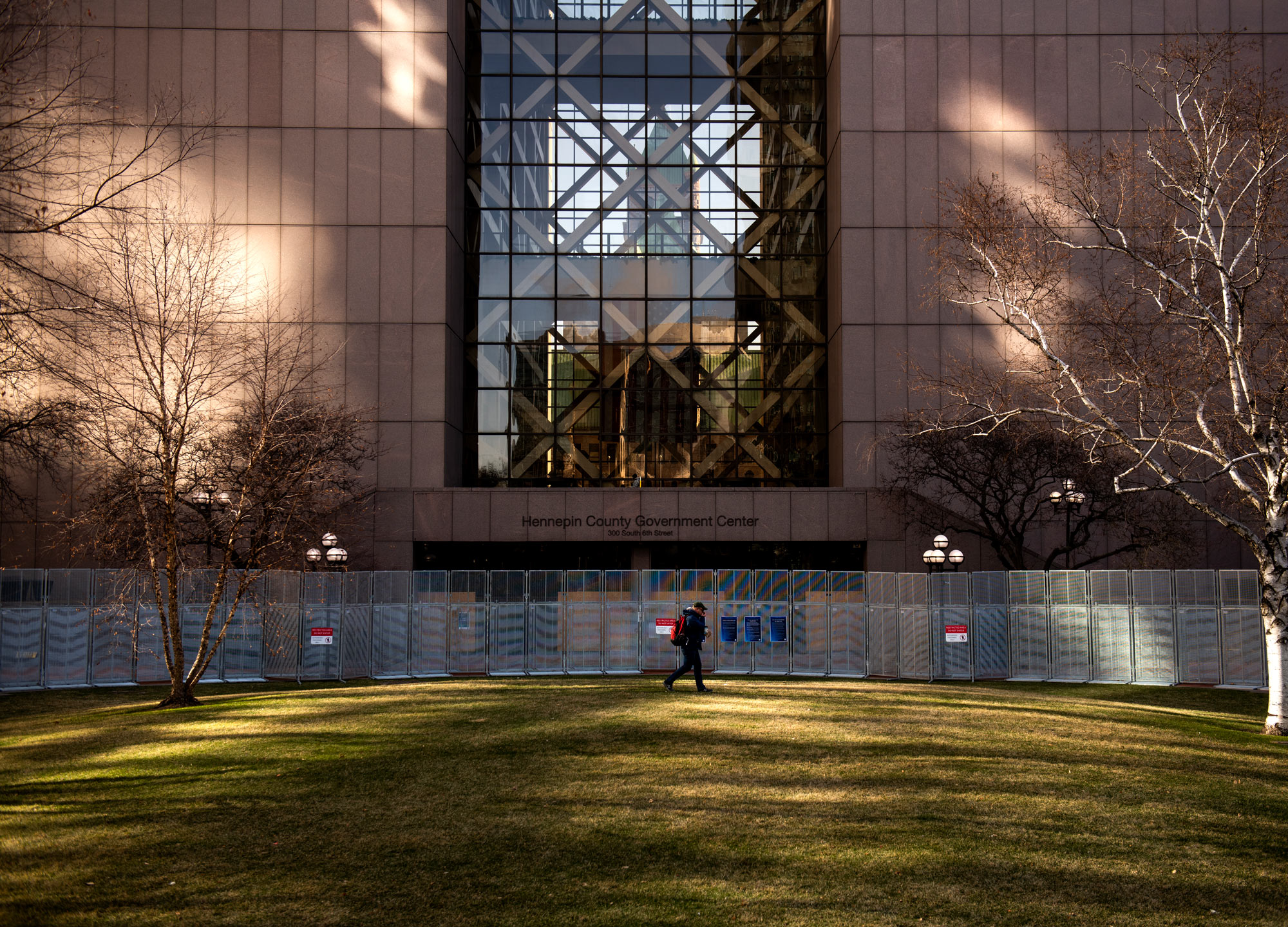 A man walks on the lawn outside the Hennepin County Government Center on April 1 in Minneapolis, Minnesota.