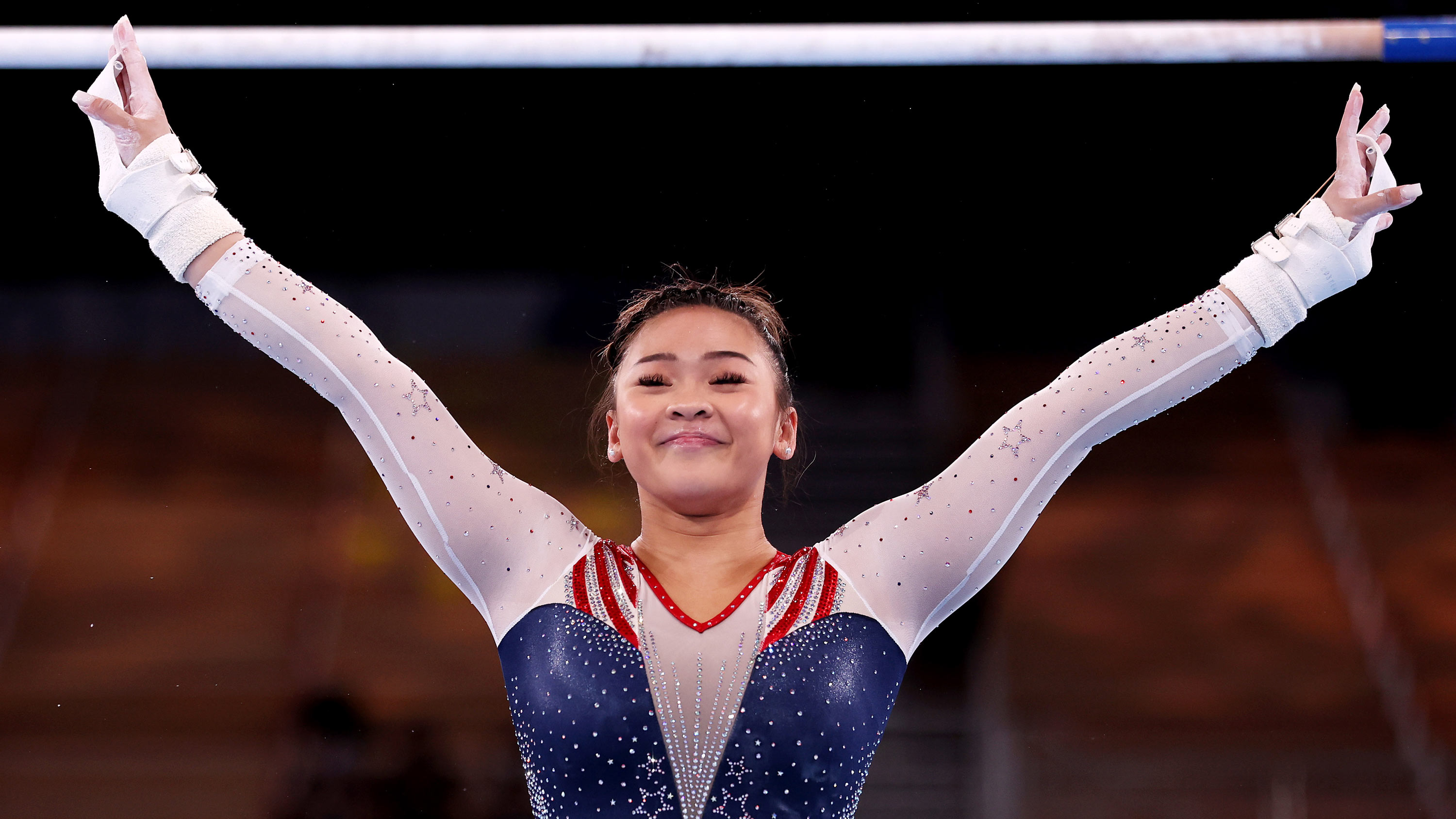 TOKYO, JAPAN - JULY 29: Sunisa Lee of Team United States reacts after competing on uneven bars during the Women's All-Around Final on day six of the Tokyo 2020 Olympic Games at Ariake Gymnastics Centre on July 29, 2021 in Tokyo, Japan. (Photo by