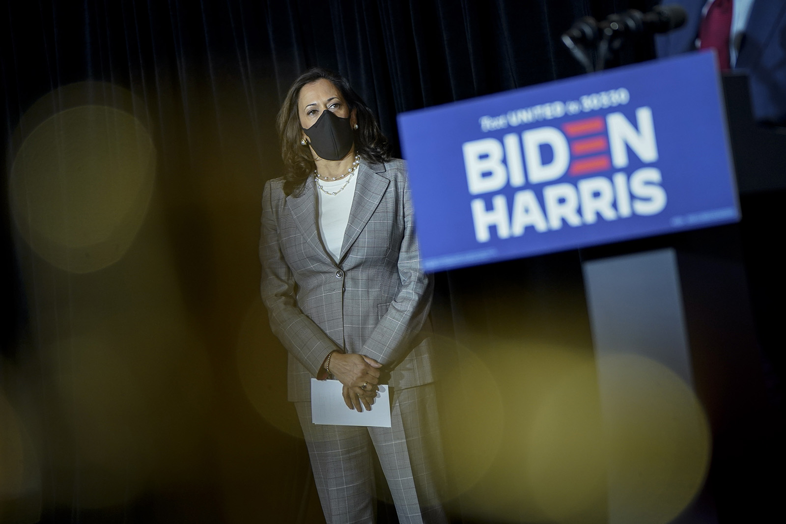Kamala Harris listens as Democratic presidential nominee Joe Biden speaks following a coronavirus briefing with health experts at the Hotel DuPont on August 13, in Wilmington, Delaware.