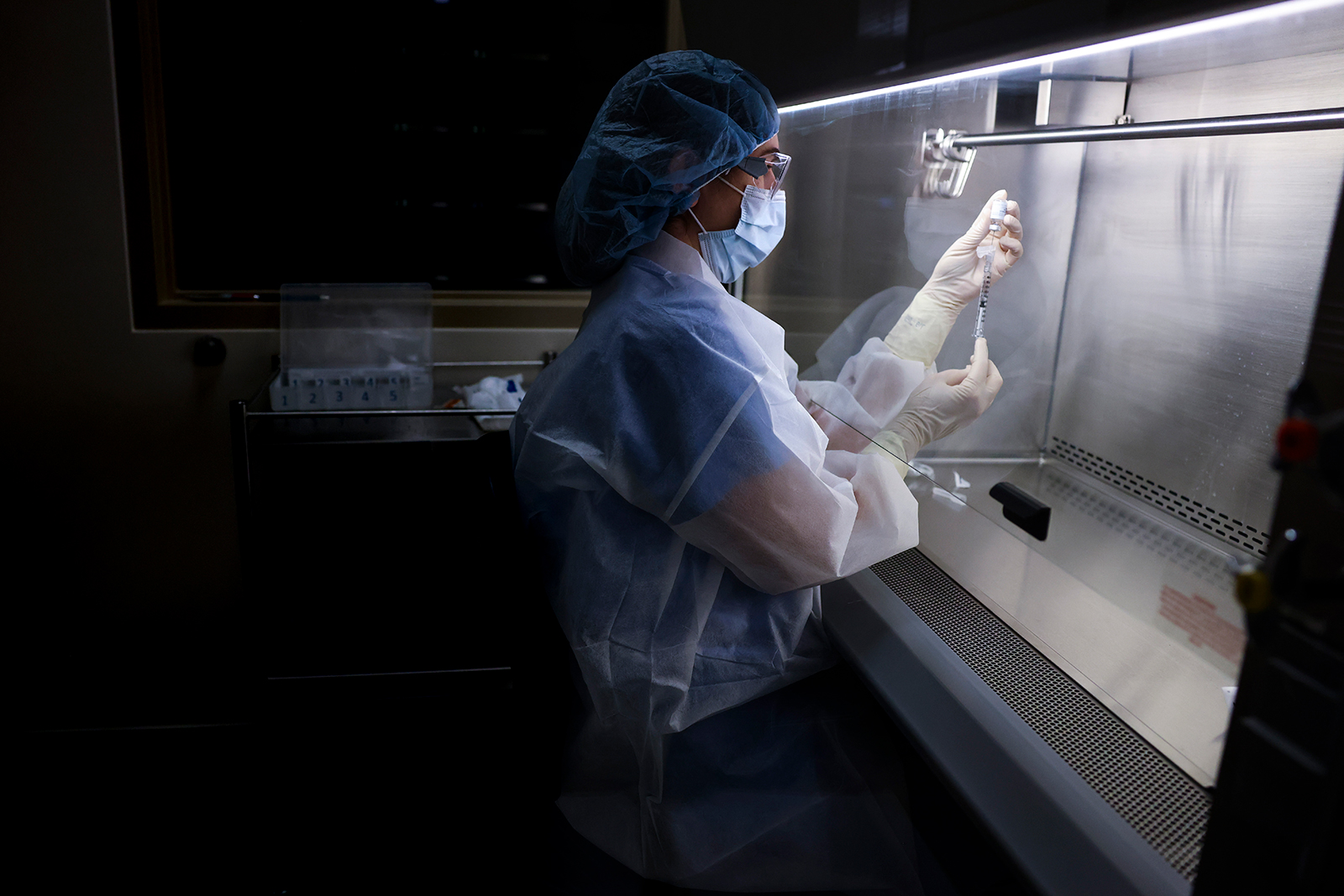 An investigational pharmacy technician prepares a dose of the Johnson & Johnson Covid-19 vaccine for a clinical trial on December 15, 2020, in Aurora, Colorado.