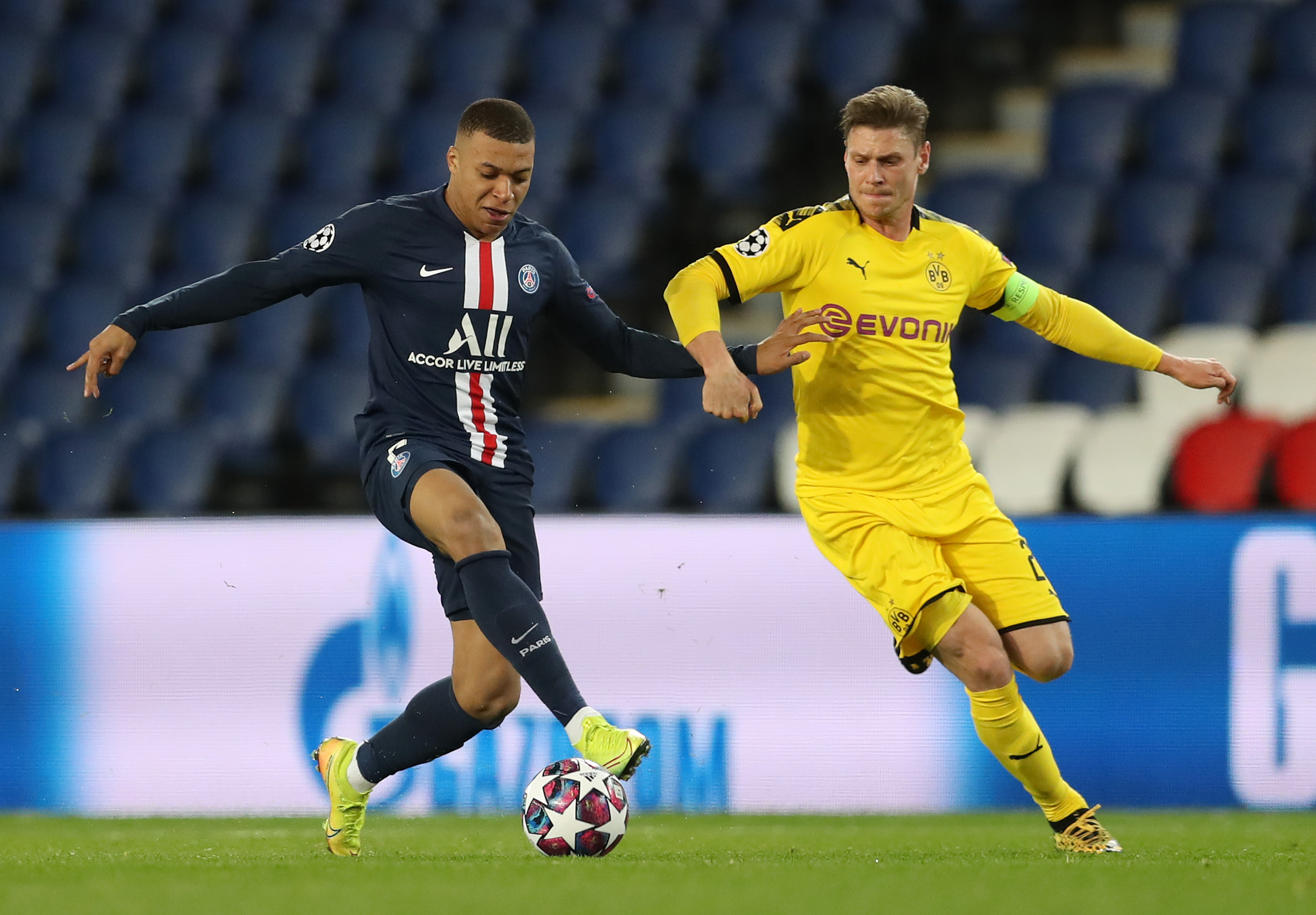 Kylian Mbappé of Paris Saint-Germain (left) is challenged by Lukasz Piszczek (right) of Borussia Dortmund during the UEFA Champions League in Paris, France on March 11.