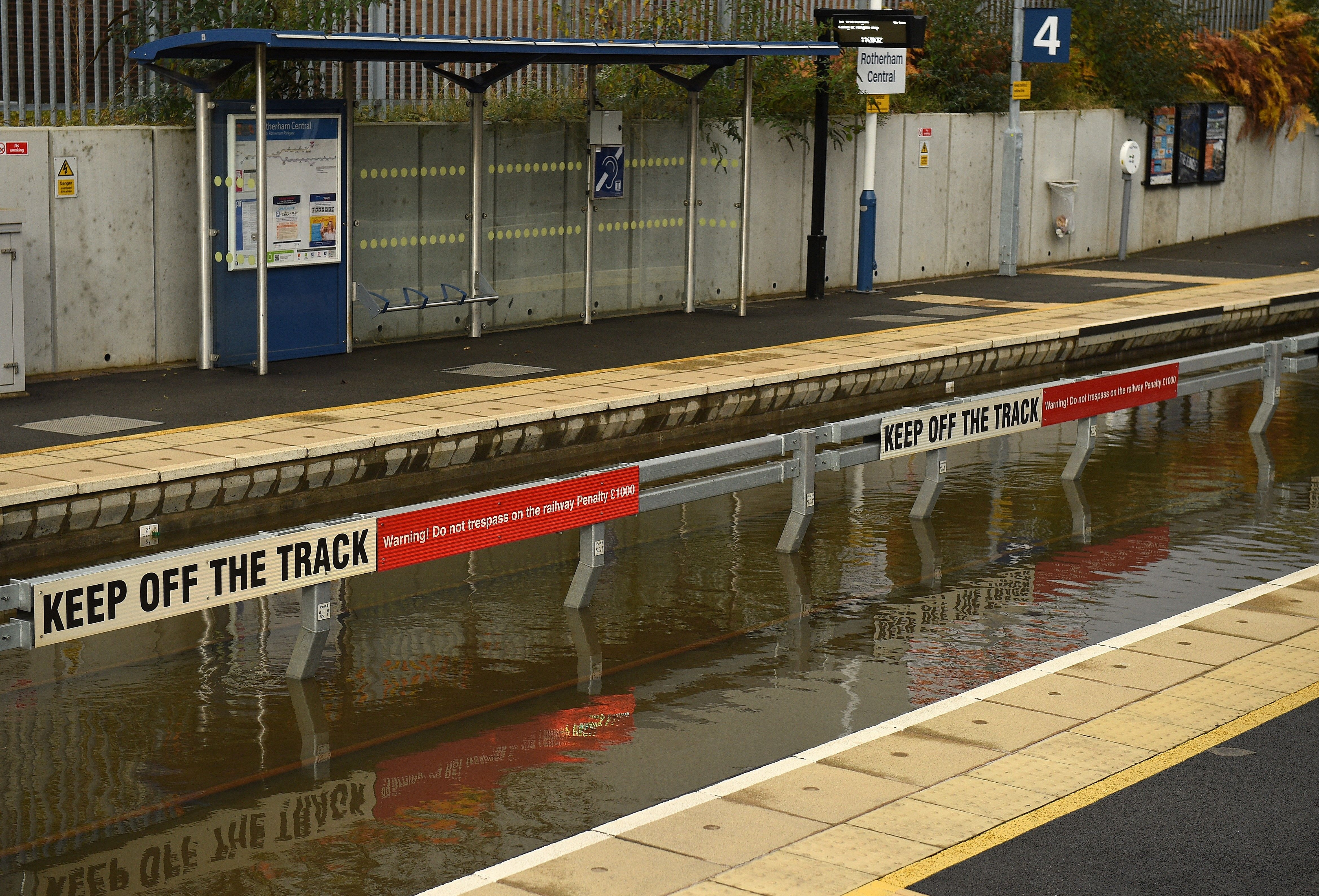 Flood water covers the rail tracks at Rotherham Central train station.