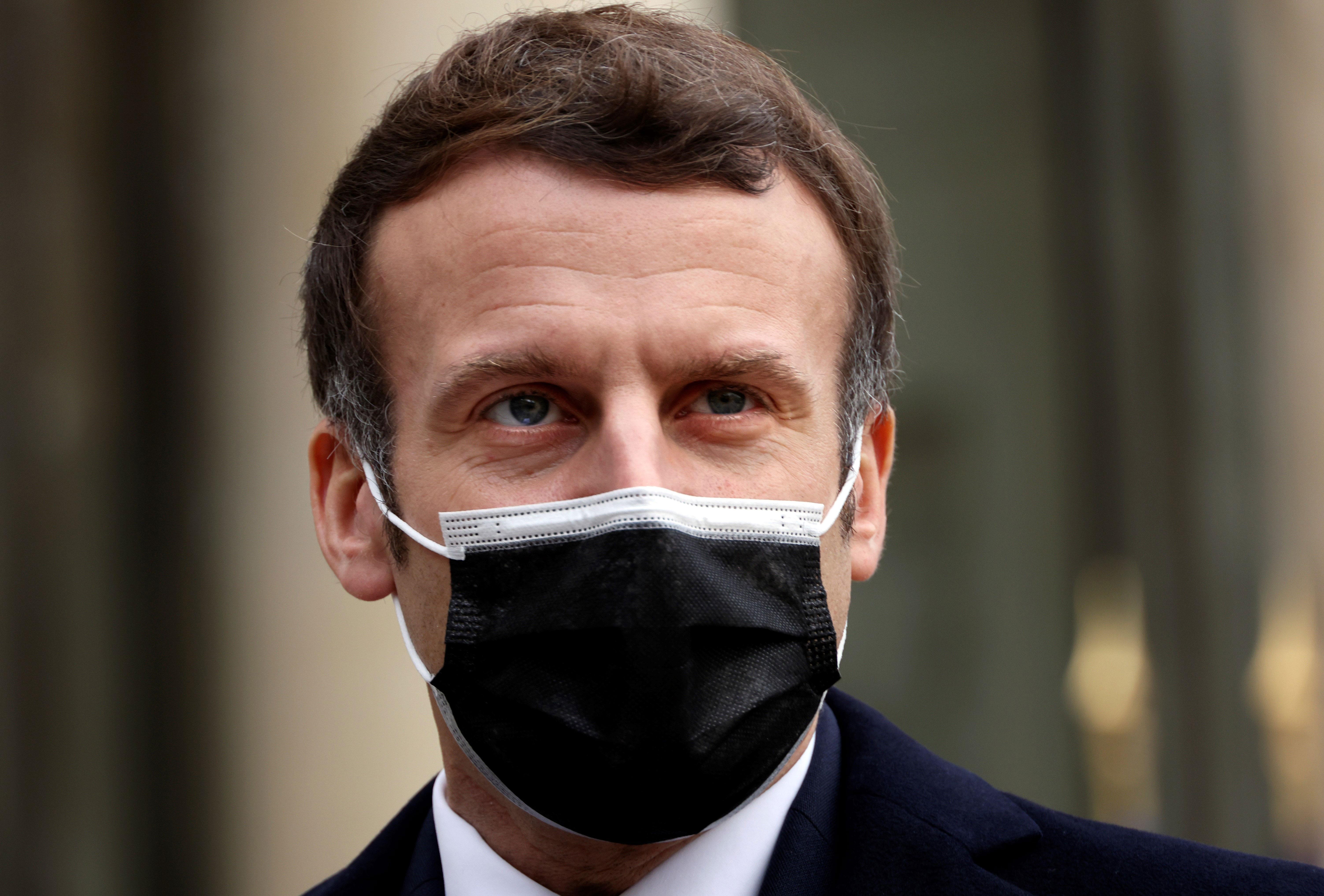 French President Emmanuel Macron speaks to the press in Paris on December 16.