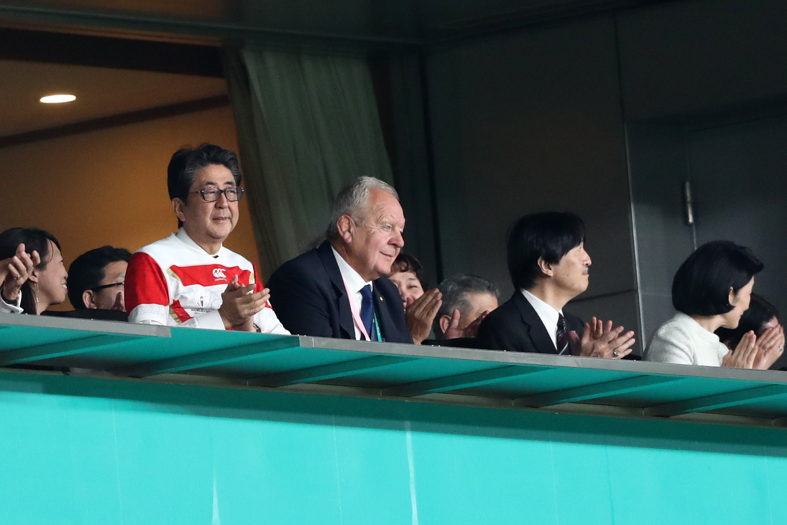 Japanese Prime Minister Shinzo Abe applauds his country's efforts against Russia.
