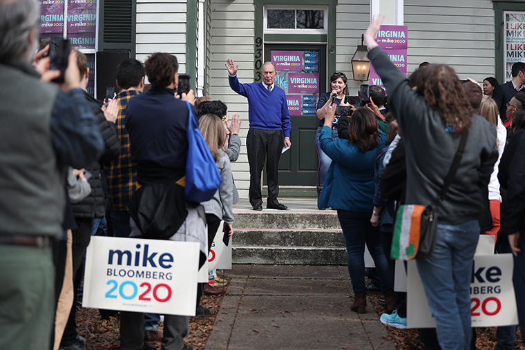 Bloomberg waves during a stop at one of his campaign offices in Manassas, Virgini, on Monday, March 2.