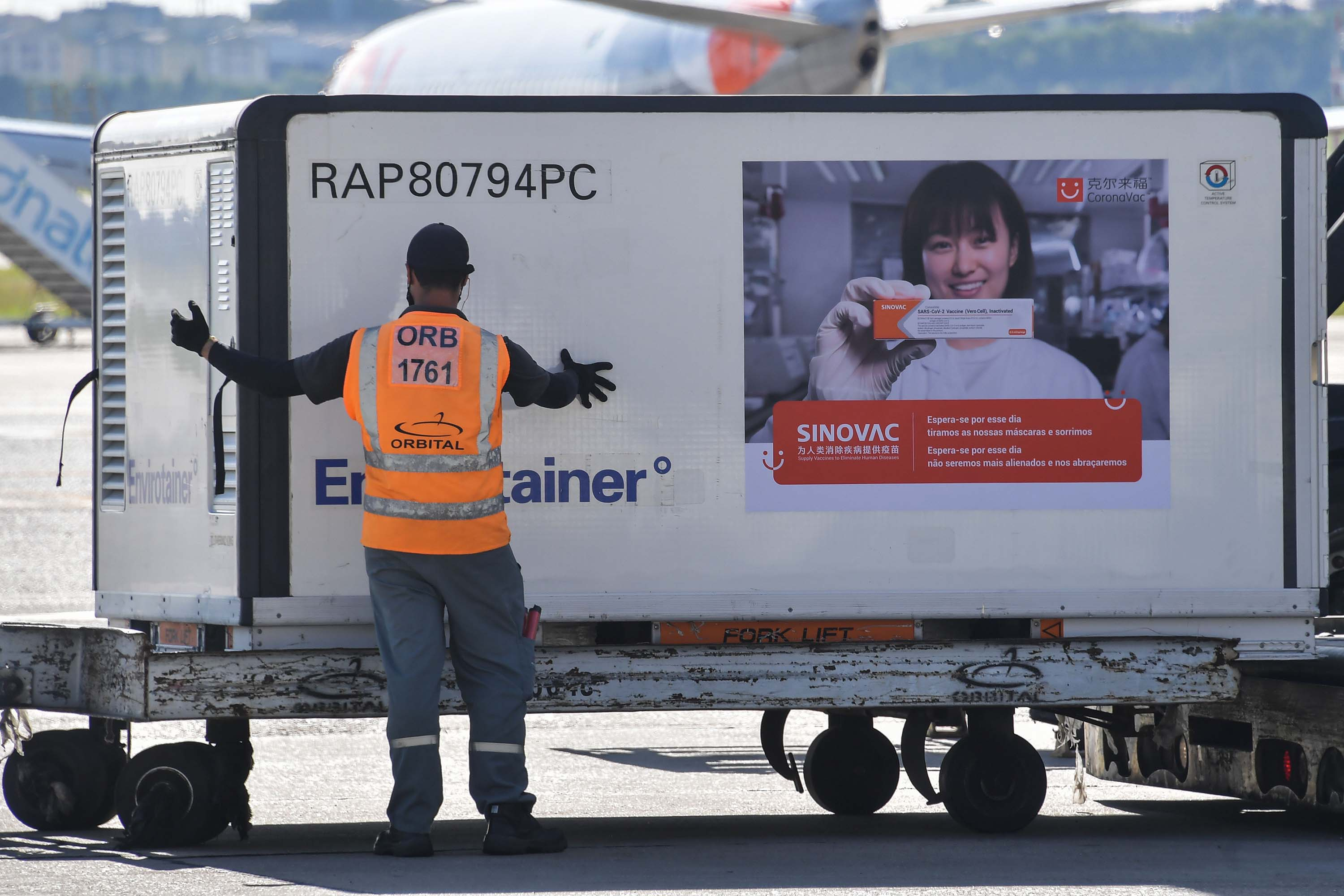 A shipment of the CoronaVac vaccine is unloaded from a cargo plane that arrived from China, at Guarulhos International Airport in Guarulhos, Brazil, on December 18.