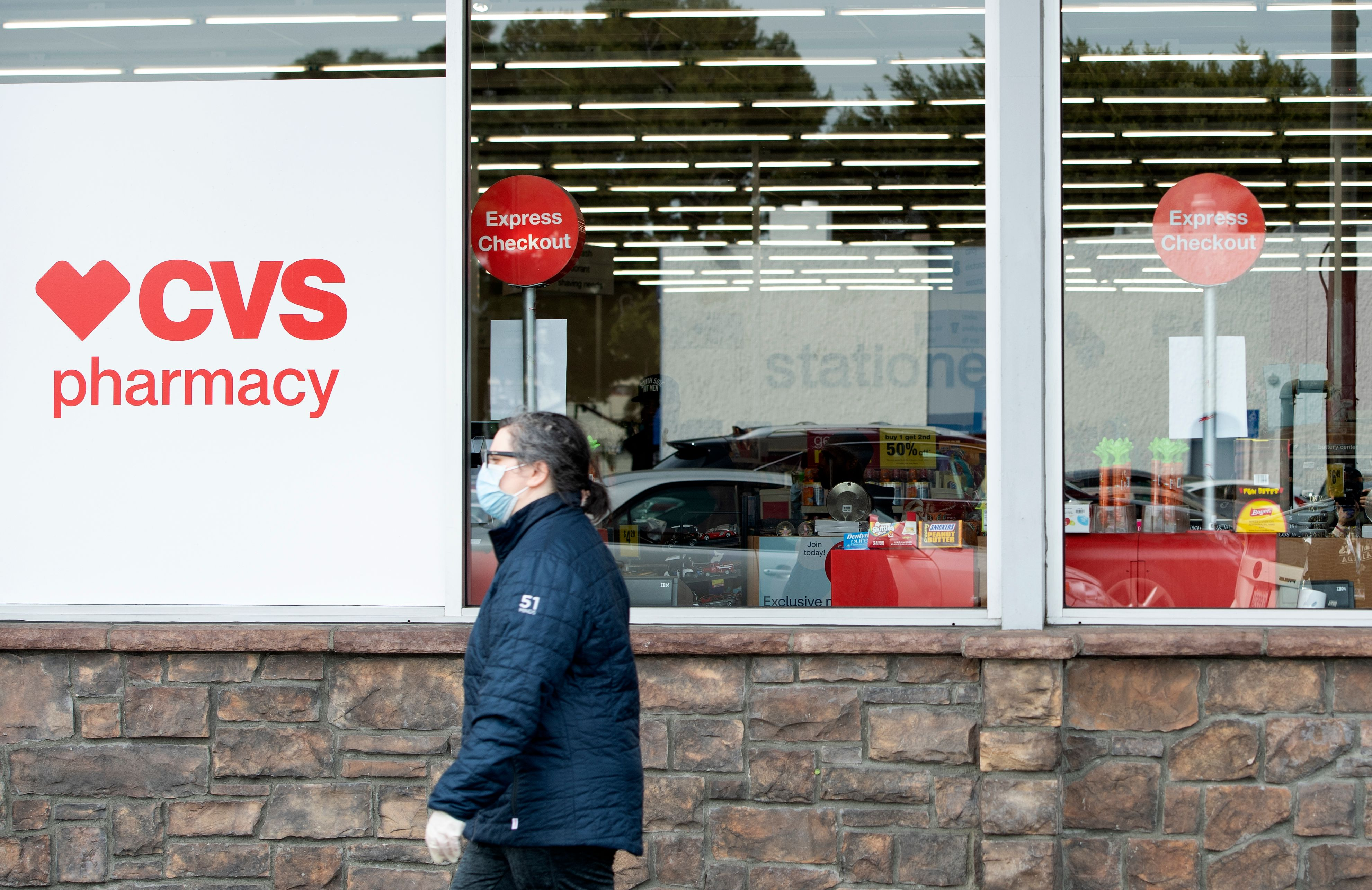 A man walks by a CVS in Los Angeles on March 31.