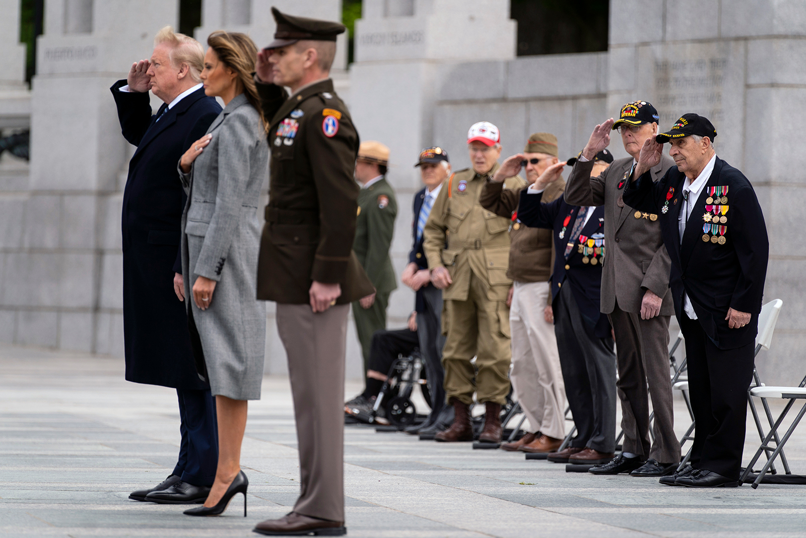 World War II veterans salute as Taps is played during a ceremony at the World War II Memorial to commemorate the 75th anniversary of Victory in Europe Day with President Donald Trump and first lady Melania Trump, on May 8, in Washington DC.
