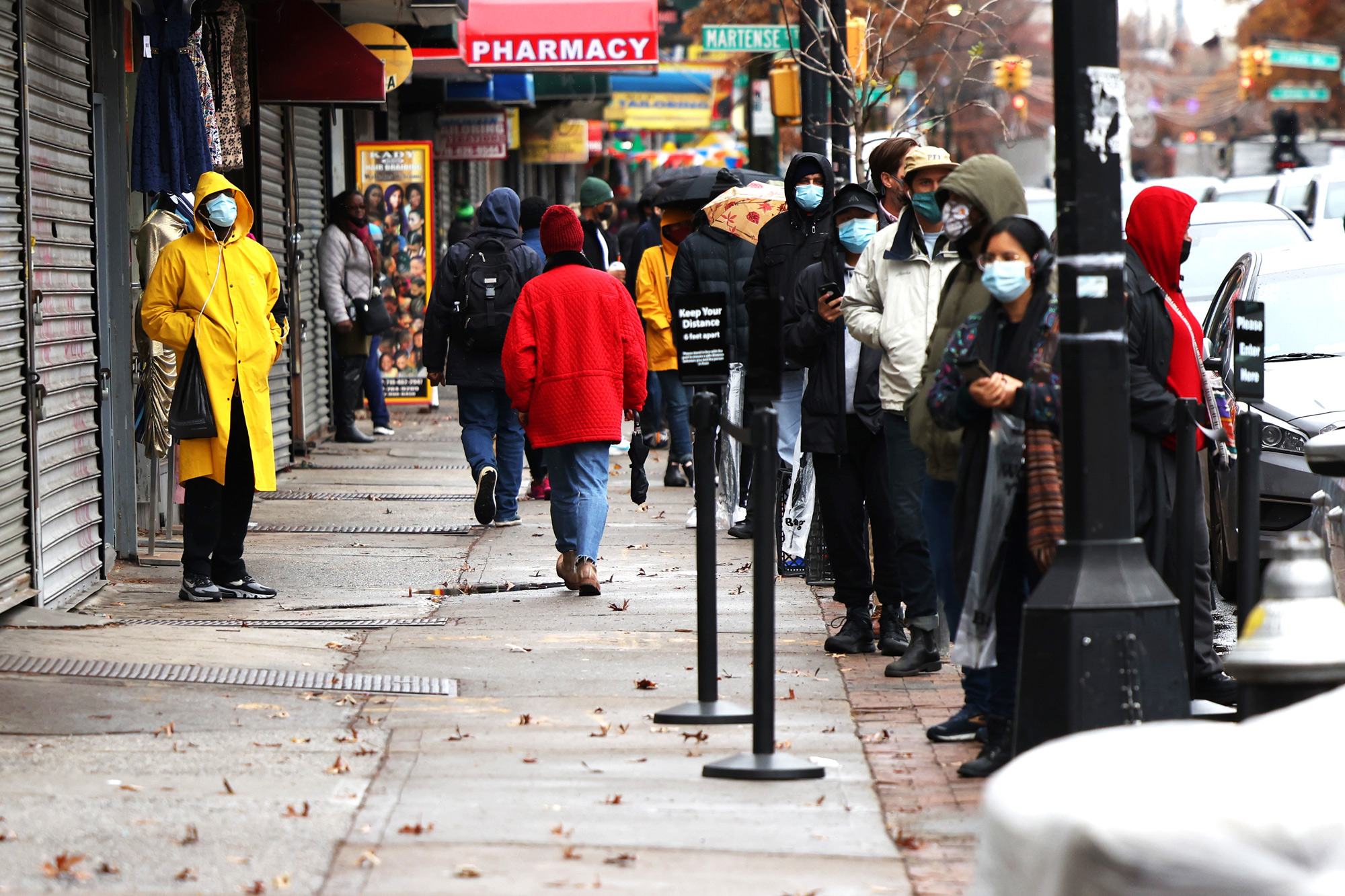 People wait in line to the enter CityMD in the Flatbush neighborhood of Brooklyn on November 23 in New York City.