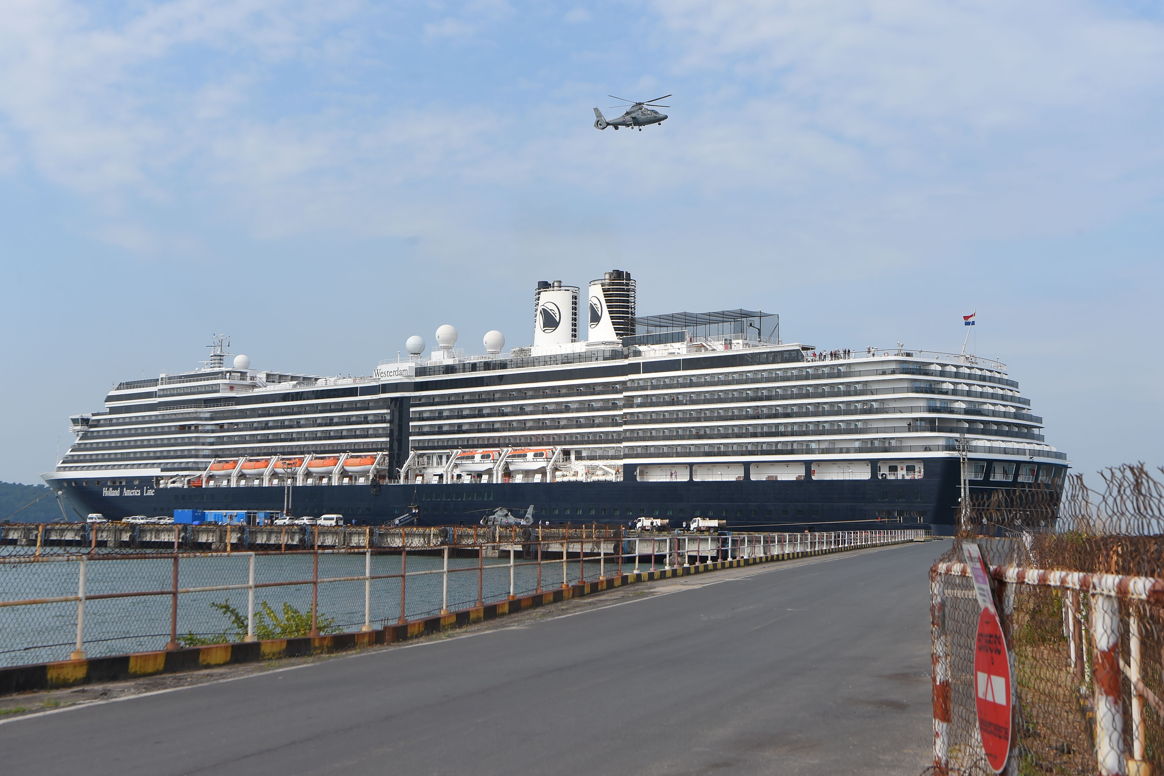 A helicopter takes off next to the Westerdam cruise ship in Sihanoukville, Cambodia.
