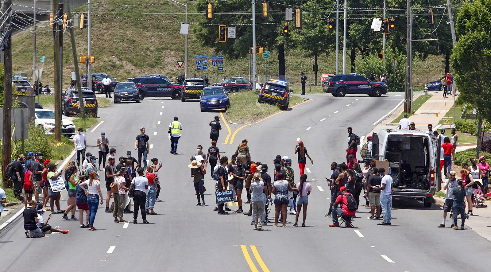 Protesters block University Avenue near the Wendy's fast food restaurant where Rayshard Brooks was shot and killed by Atlanta police on Friday evening.