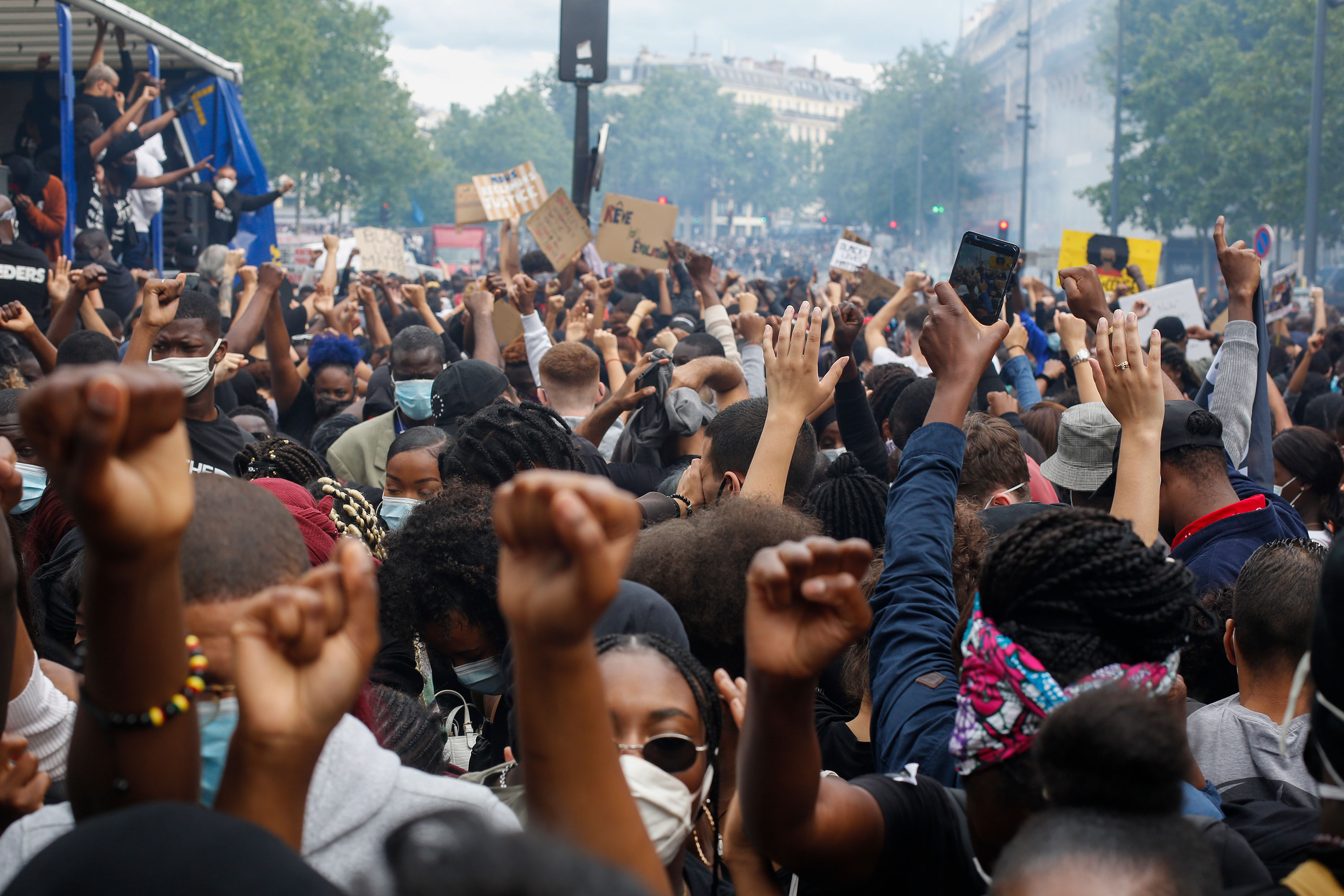 Thousands of people take part in a demonstration against police brutality and racism in Paris on Saturday, June 13.