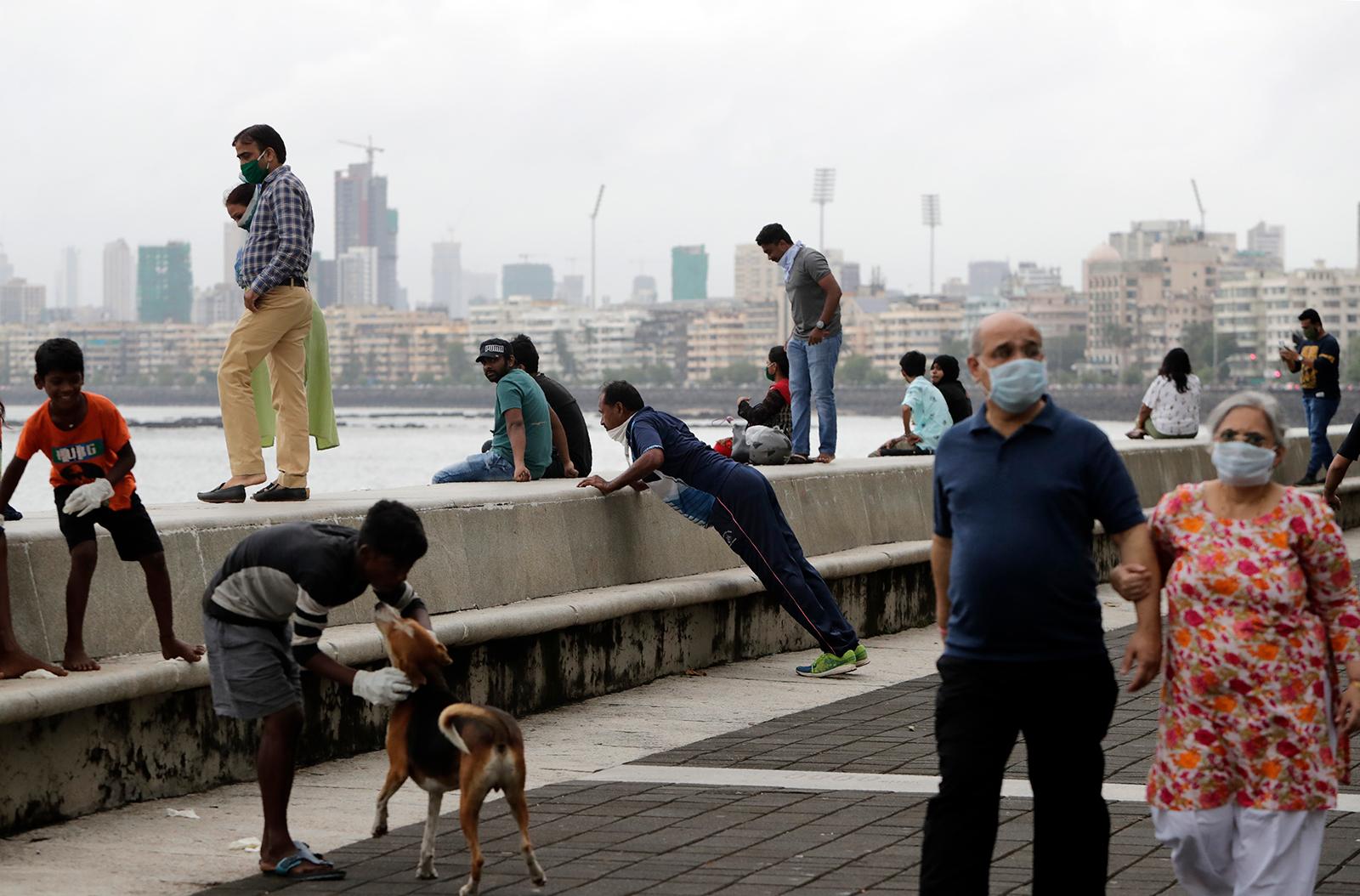 People spend time outside on the Arabian Sea coast in Mumbai, on Thursday, September 17.