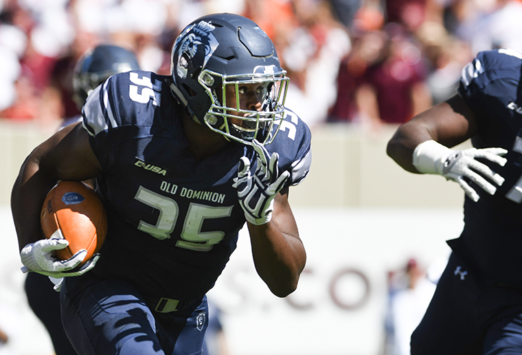 Running back Jeremy Cox #35 of the Old Dominion University Monarchs carries the ball against the Virginia Tech Hokies in the first half at Lane Stadium on September 23, 2017 in Blacksburg, Virginia.
