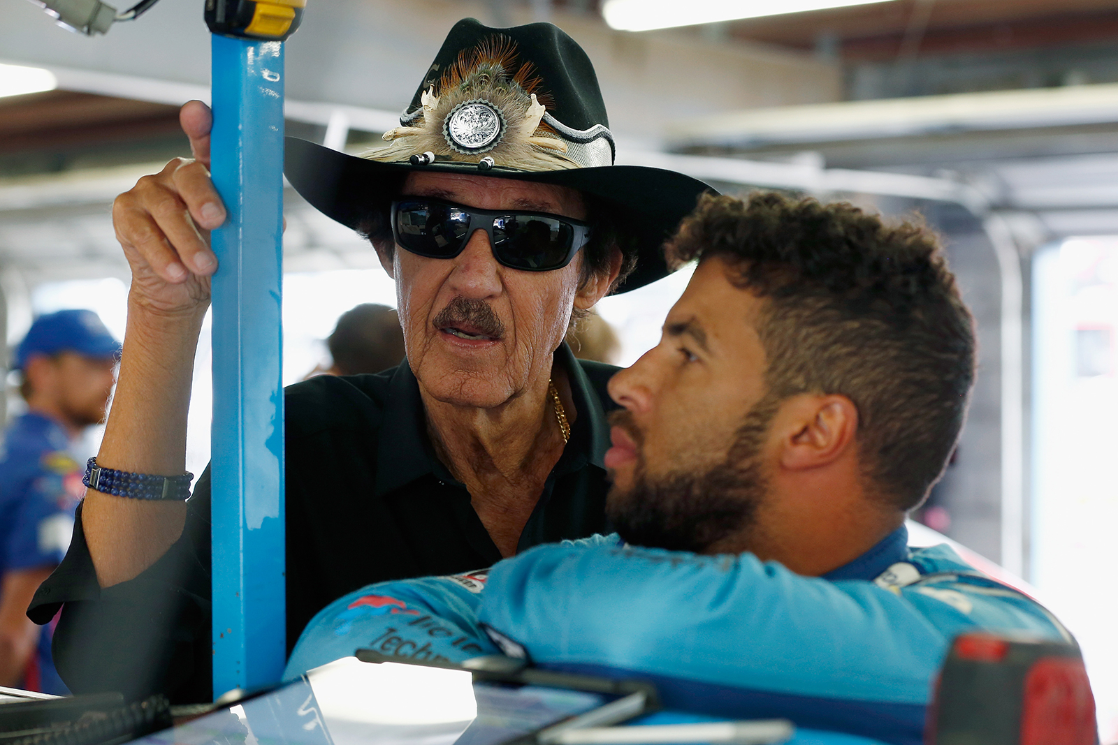 Bubba Wallace (right), driver of the #43 Medallion Bank/Petty's Garage Chevrolet, speaks with team owner and NASCAR Hall of Famer Richard Petty (left) at New Hampshire Motor Speedway in Loudon, New Hampshire on July 21, 2018.