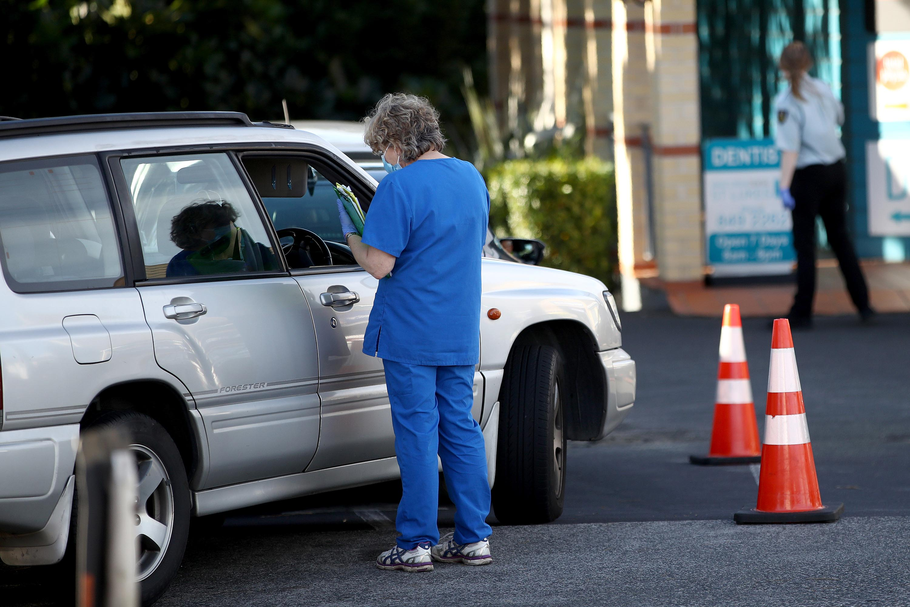 People queue in cars at a coronavirus testing center in Auckland, New Zealand, on June 17.