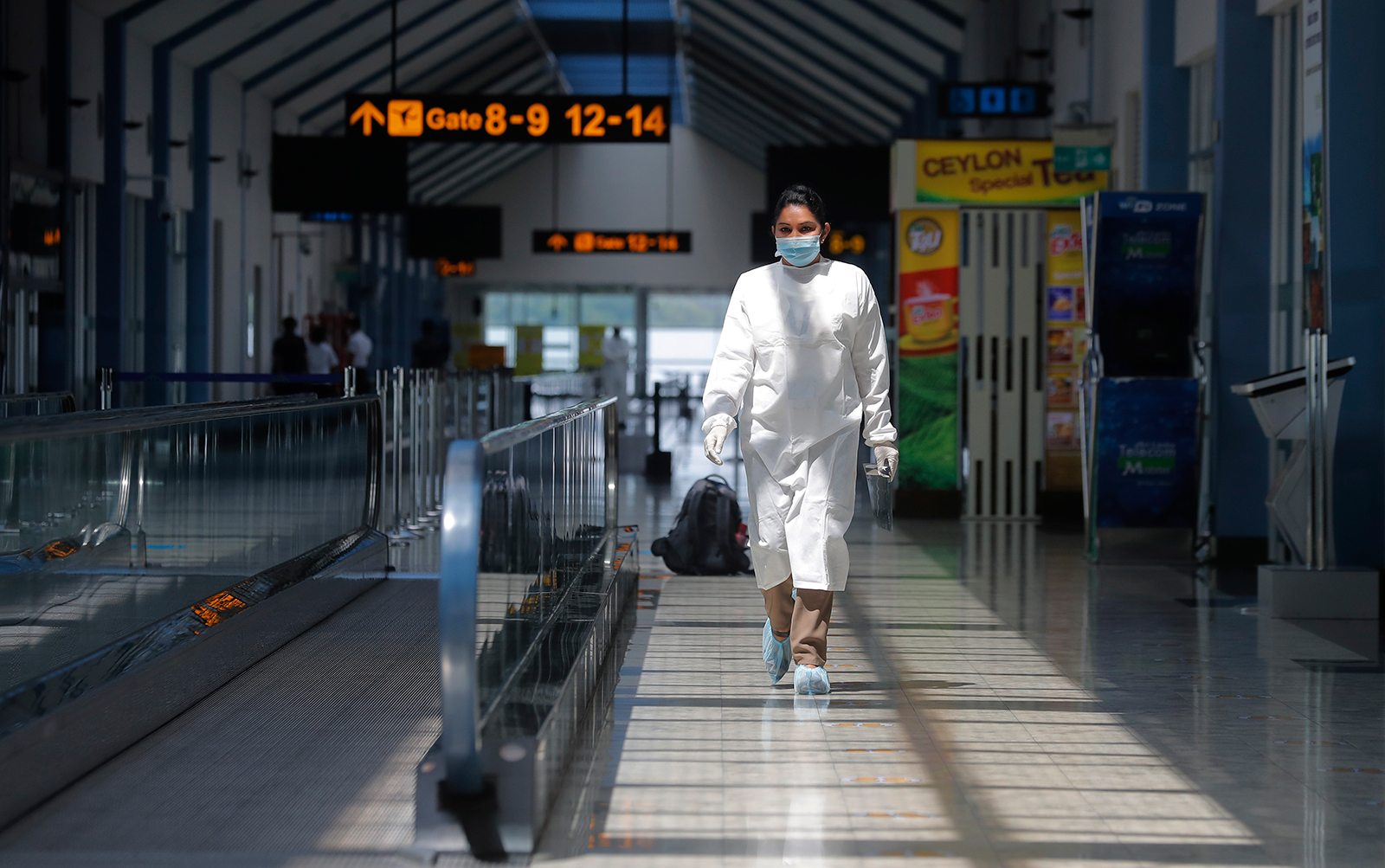 A Sri Lankan airport worker walks inside a terminal at the Katunayake International Airport in Colombo, Sri Lanka, on January 20.