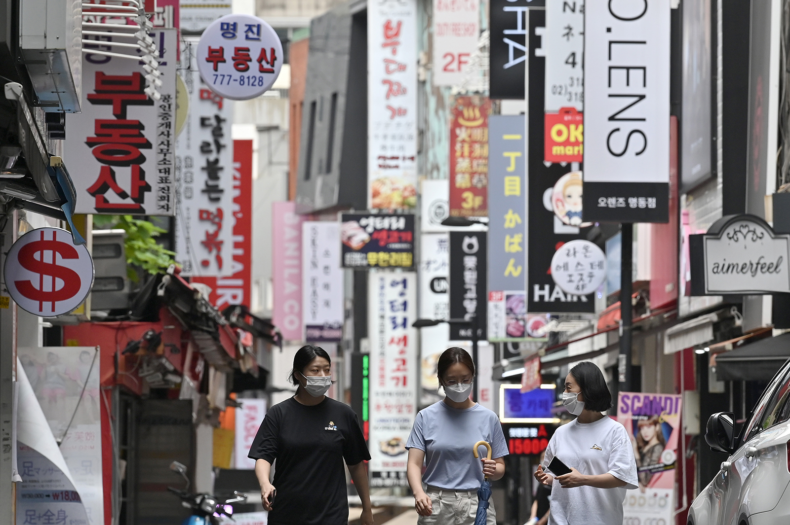 People walk through the Myeongdong shopping district in Seoul, South Korea, on August 27.