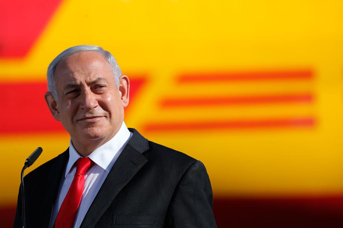 Israeli Prime Minister Benjamin Netanyahu attends the arrival of over 100,000 of doses of the Pfizer coronavirus vaccines at the Ben Gurion Airport near Tel Aviv, Israel, on Wednesday, December  9.