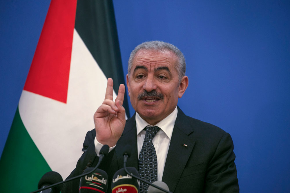 Palestinian Prime Minister Mohammad Shtayyeh gestures as he talks to reporters during a press conference in Ramallah on May 5.