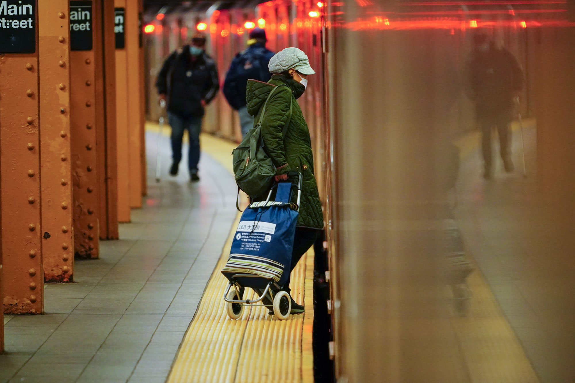 A person enters a train in Main St., Flushing, New York, on May 4.