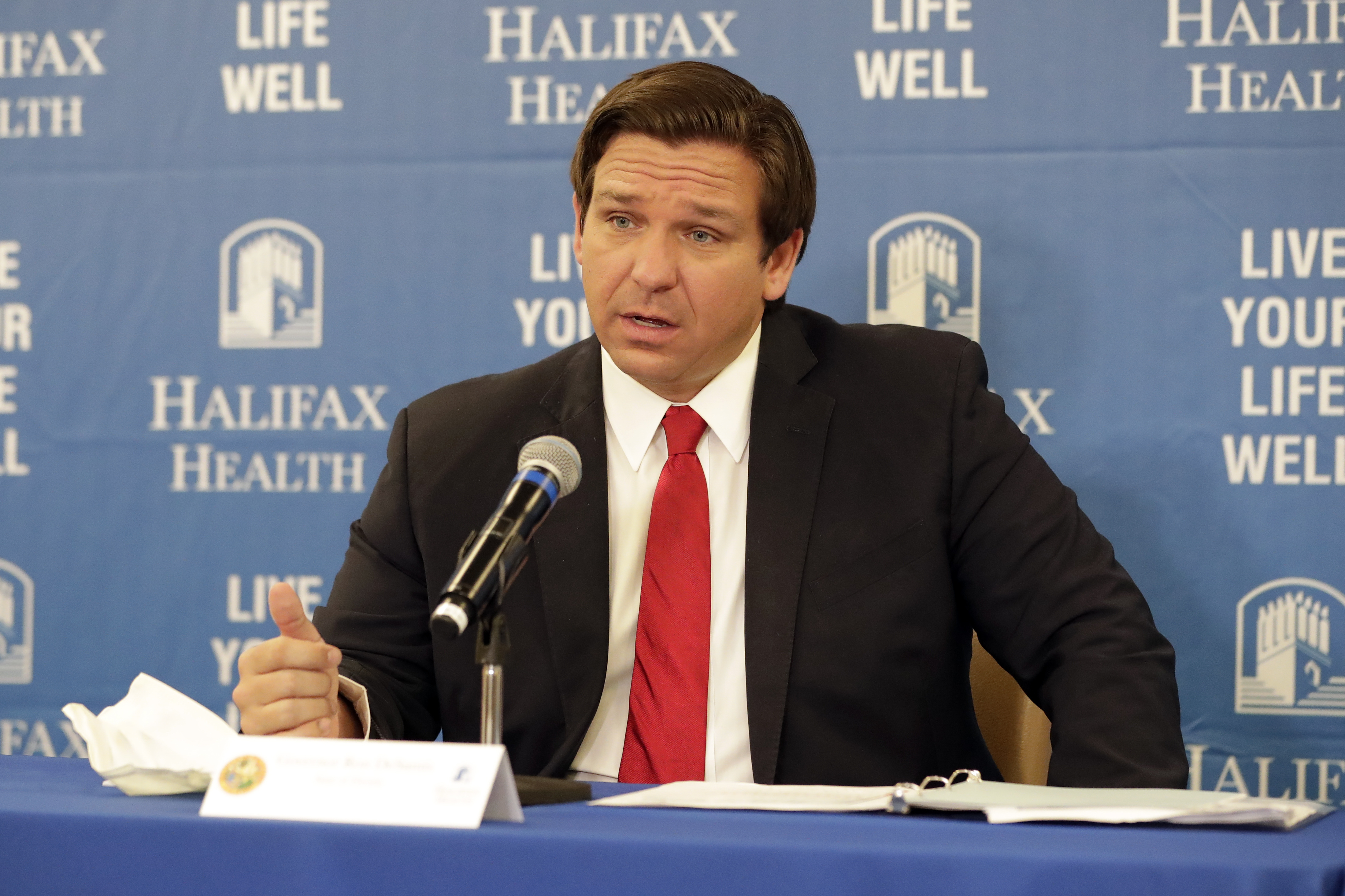 Florida Gov. Ron DeSantis speaks at a news conference at Halifax Health Medical Center in Daytona Beach, Florida, on May 3.