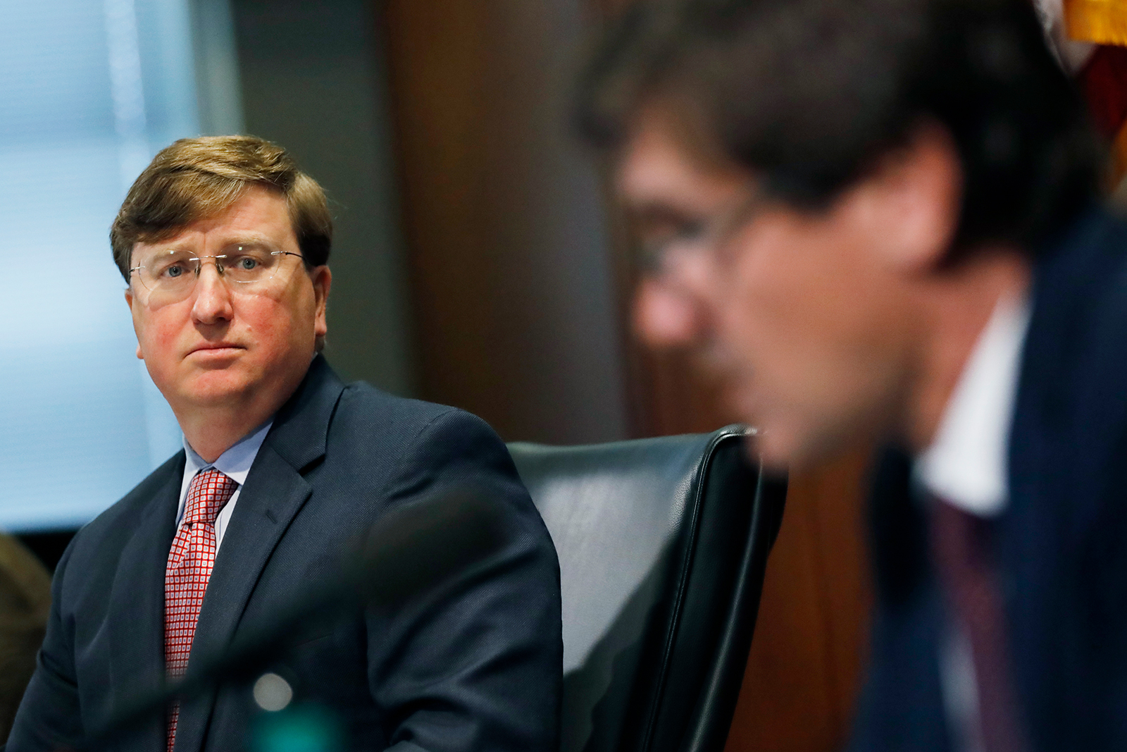 Mississippi Gov. Tate Reeves, left, listens as State Health Officer Dr. Thomas Dobbs, discusses the state's efforts to reduce and limit transmission from the COVID-19 virus, Monday, July 20, during a press briefing in Jackson.