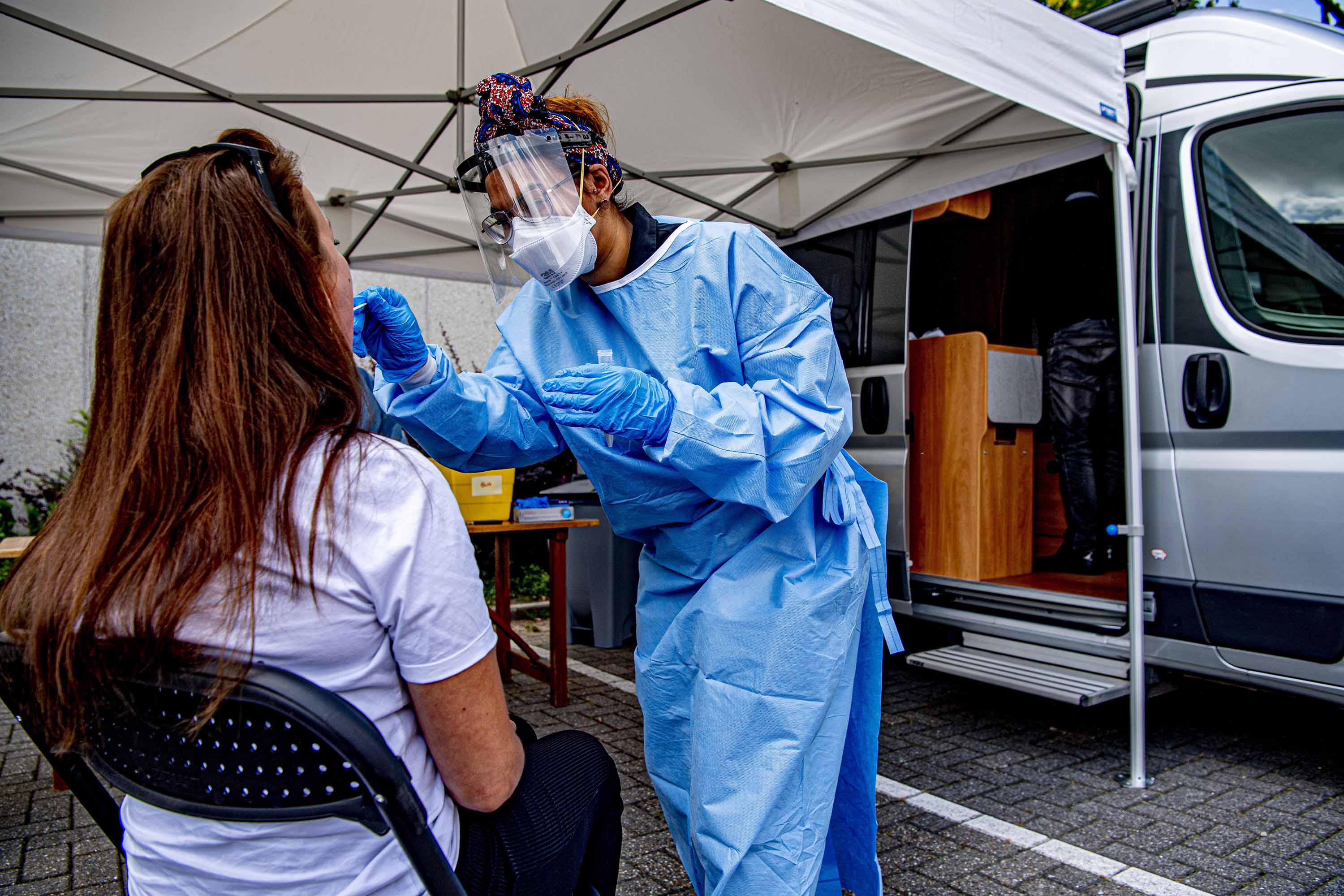 A health worker collects a sample during coronavirus screening in Maassluis, Netherlands on June 18.
