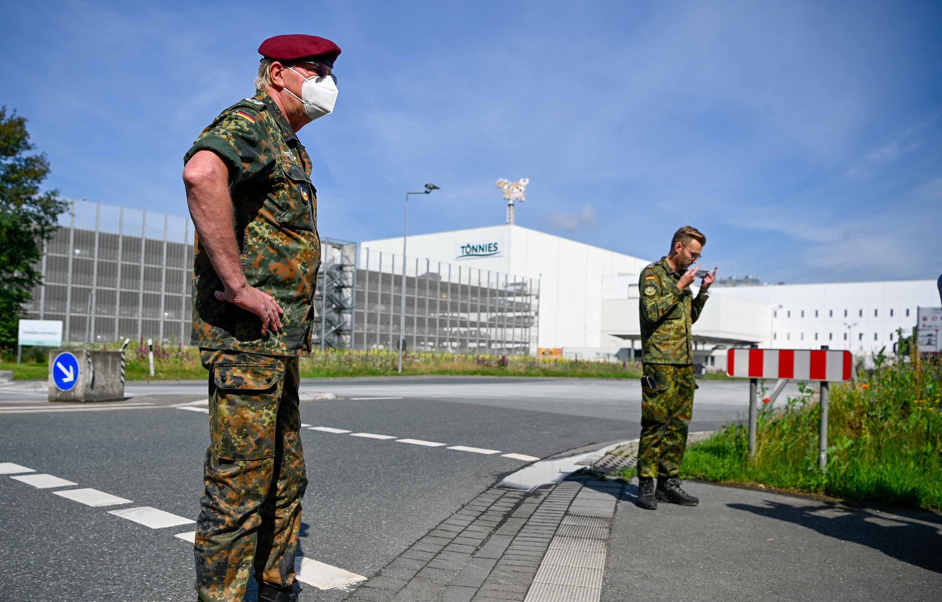 Members of the German armed forces prepare to help with taking throat swab samples for Covid-19 testing of employees at the Toennies meat packing plant in Guetersloh, Germany on June 19.